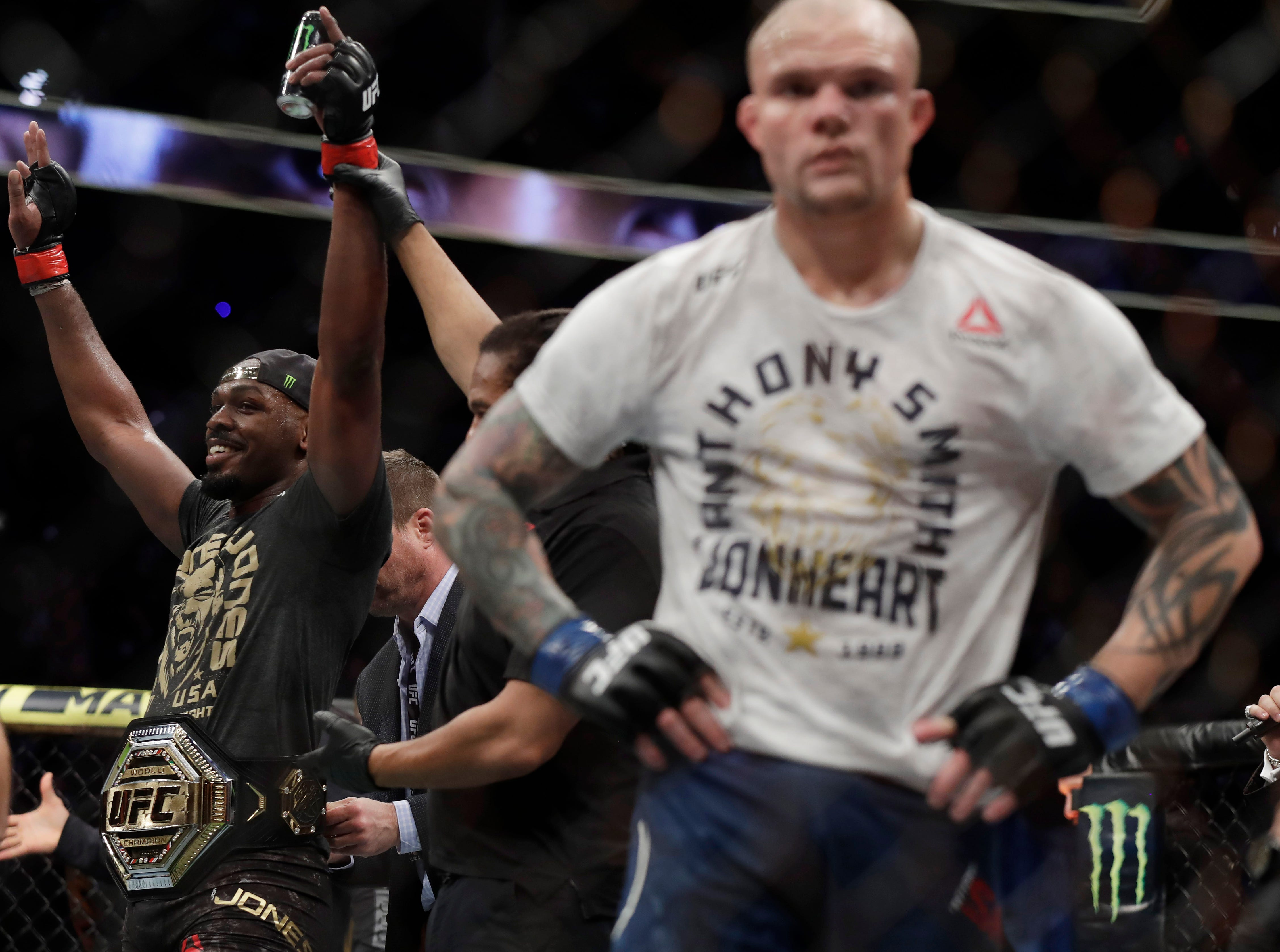 LAS VEGAS, NEVADA - MARCH 02: Jon Jones (L) celebrates after defeating Anthony Smith (R) following their light heavyweight title bout during UFC 235 at T-Mobile Arena on March 02, 2019 in Las Vegas, Nevada. Jones won by unanimous decision.  (Photo by Isaac Brekken/Getty Images)