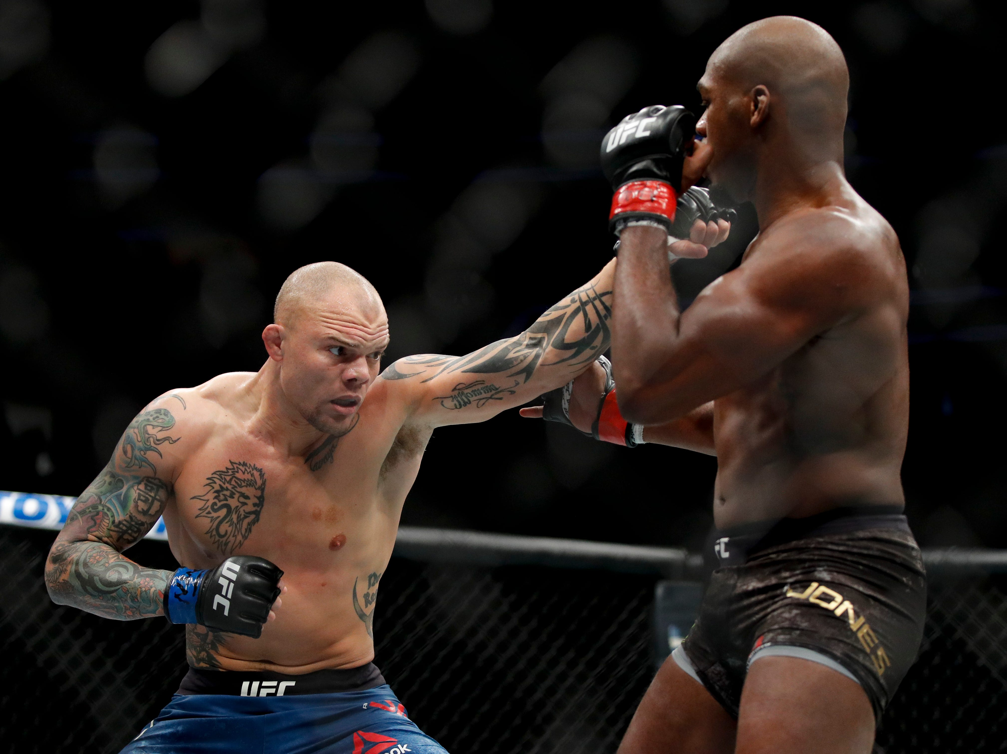 Jon Jones, right, blocks a punch from Anthony Smith during a light heavyweight mixed martial arts title bout at UFC 235, Saturday, March 2, 2019, in Las Vegas. (AP Photo/John Locher)