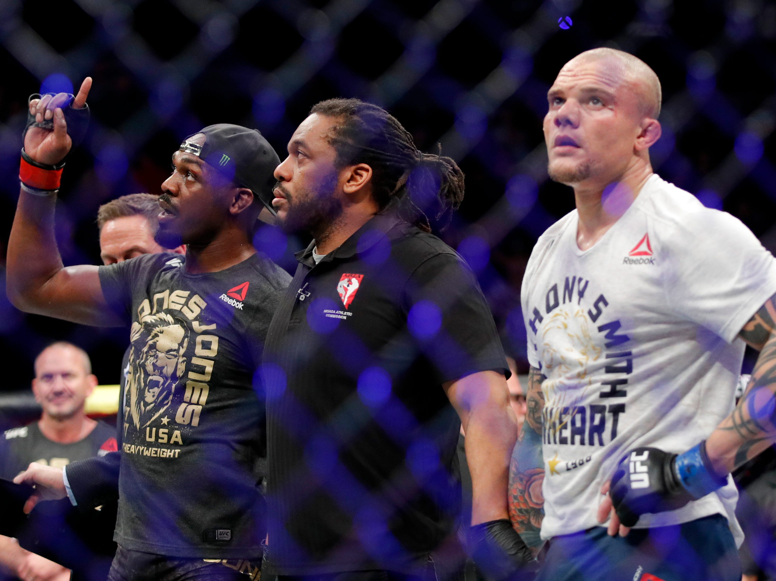 Jon Jones, left, celebrates after his win against Anthony Smith in a light heavyweight mixed martial arts title bout at UFC 235, Saturday, March 2, 2019, in Las Vegas. (AP Photo/John Locher)