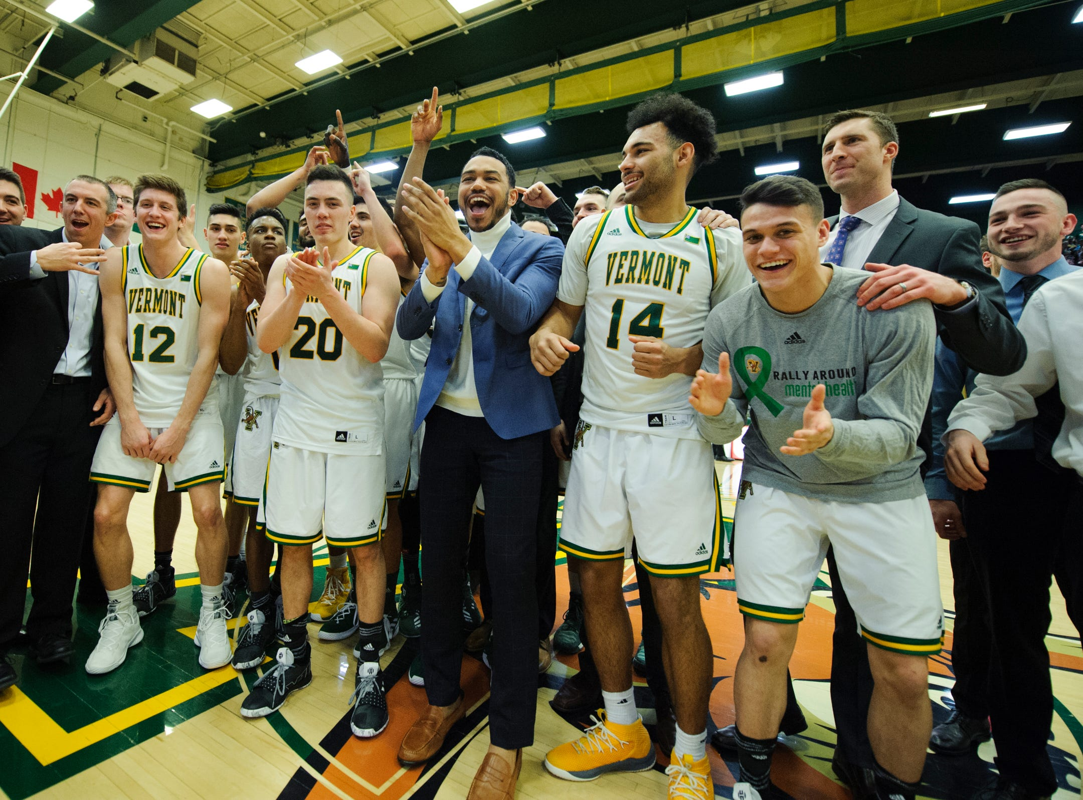 Vermont celebrates the American East regular season championship during the men's basketball game between the Stony Brook Seawolves and the Vermont Catamounts at Patrick Gym on Saturday night March 2, 2019 in Burlington, Vermont.