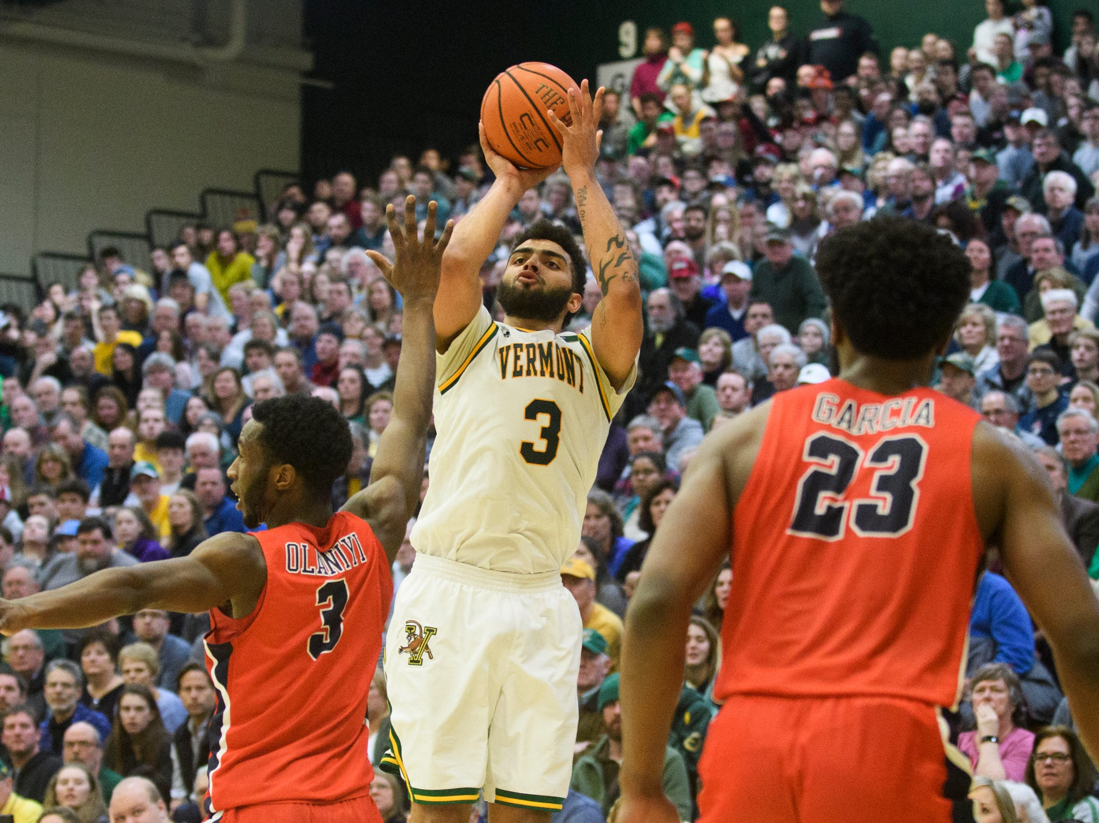 Vermont forward Anthony Lamb (3) shoots the ball over Stony Brook's Elijah Olaniyi (3) during the men's basketball game between the Stony Brook Seawolves and the Vermont Catamounts at Patrick Gym on Saturday night March 2, 2019 in Burlington, Vermont.