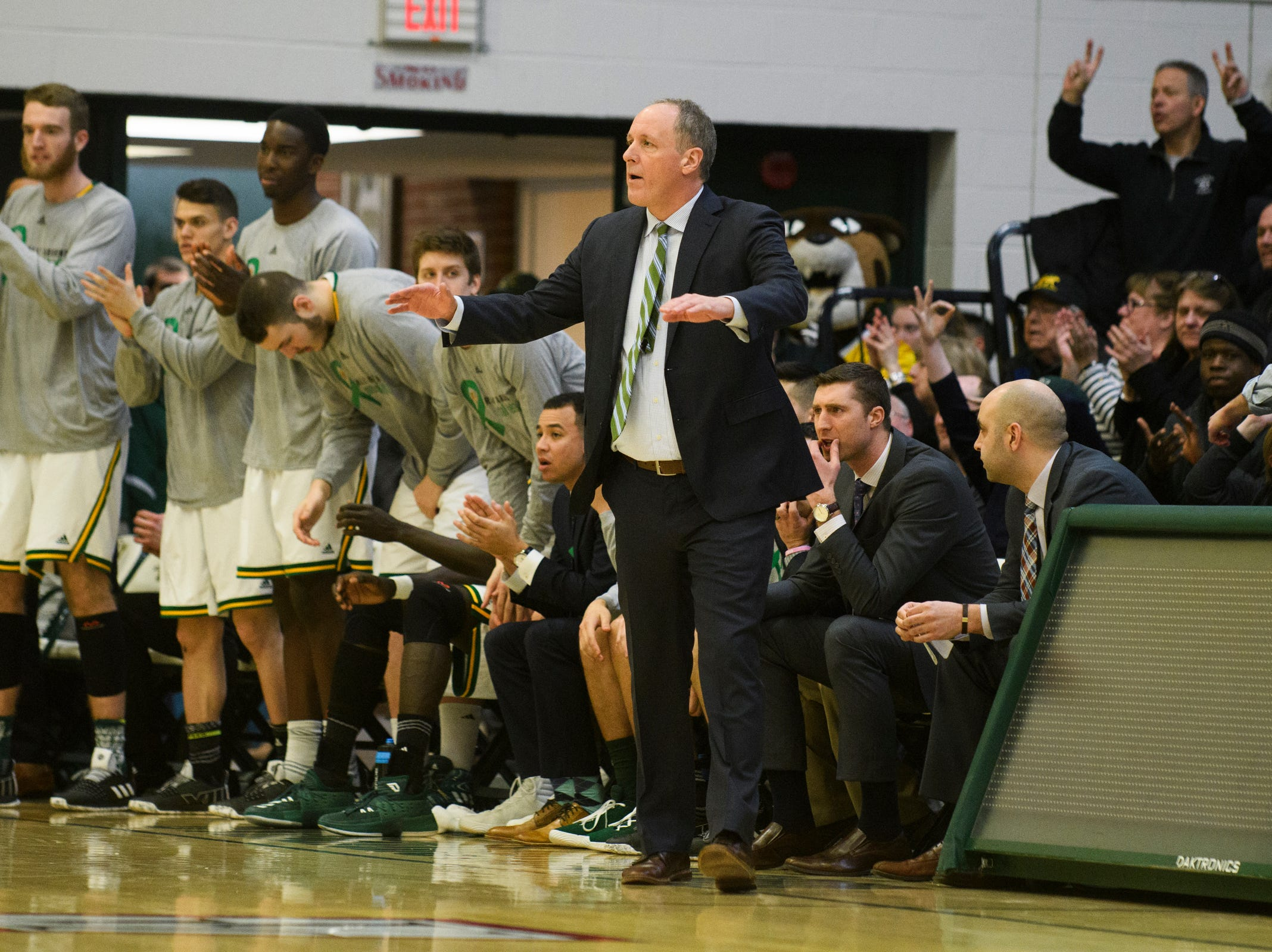 Vermont head coach John Becker talks to the team on the court during the men's basketball game between the Stony Brook Seawolves and the Vermont Catamounts at Patrick Gym on Saturday night March 2, 2019 in Burlington, Vermont.