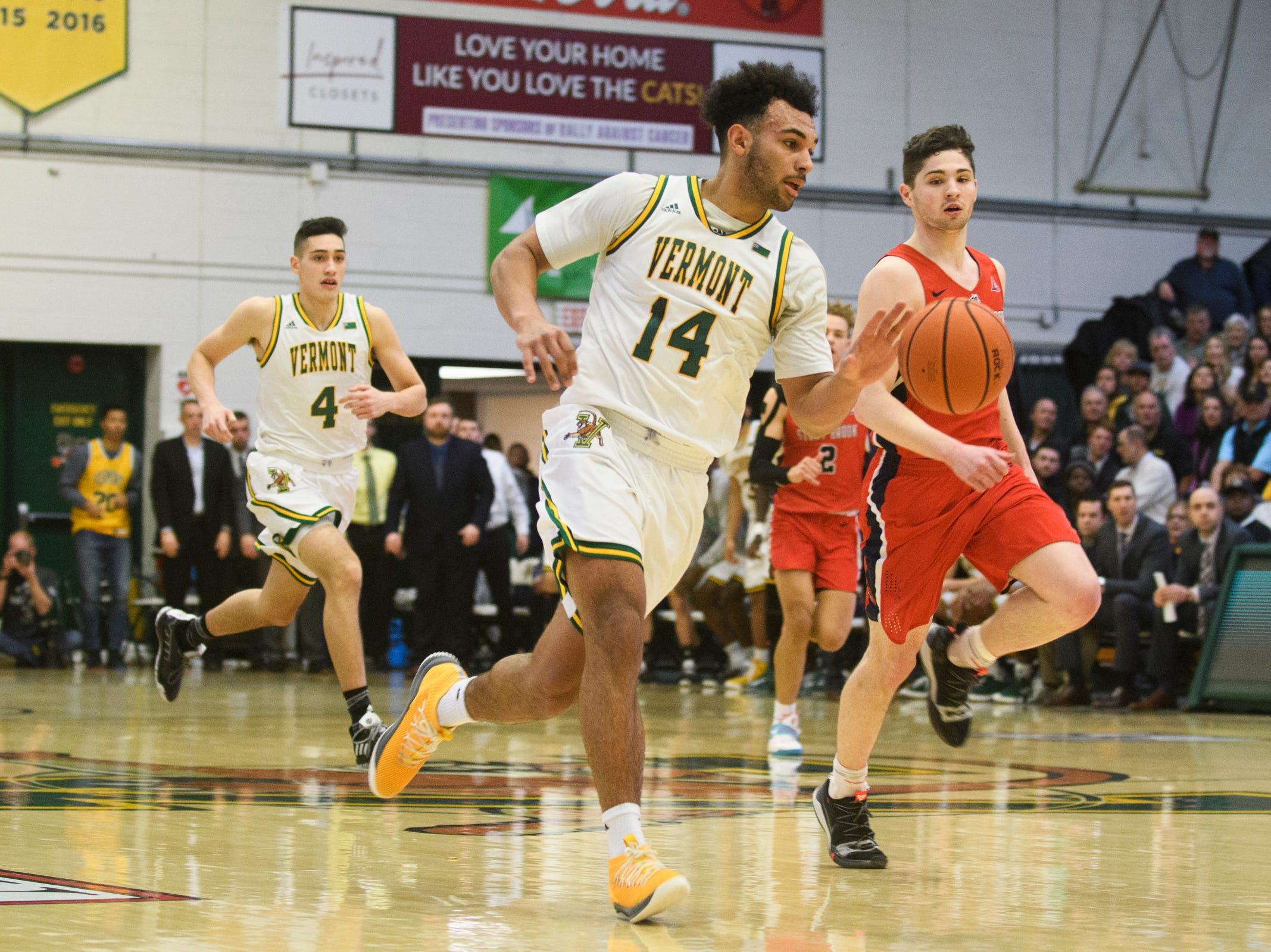 Vermont forward Isaiah Moll (14) drives to the hoop during the men's basketball game between the Stony Brook Seawolves and the Vermont Catamounts at Patrick Gym on Saturday night March 2, 2019 in Burlington, Vermont.
