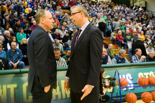 Vermont head coach John Becker talks to Stony Brook head coach Jeff Boals during the men's basketball game between the Stony Brook Seawolves and the Vermont Catamounts at Patrick Gym on Saturday night March  2, 2019 in Burlington, Vermont.
