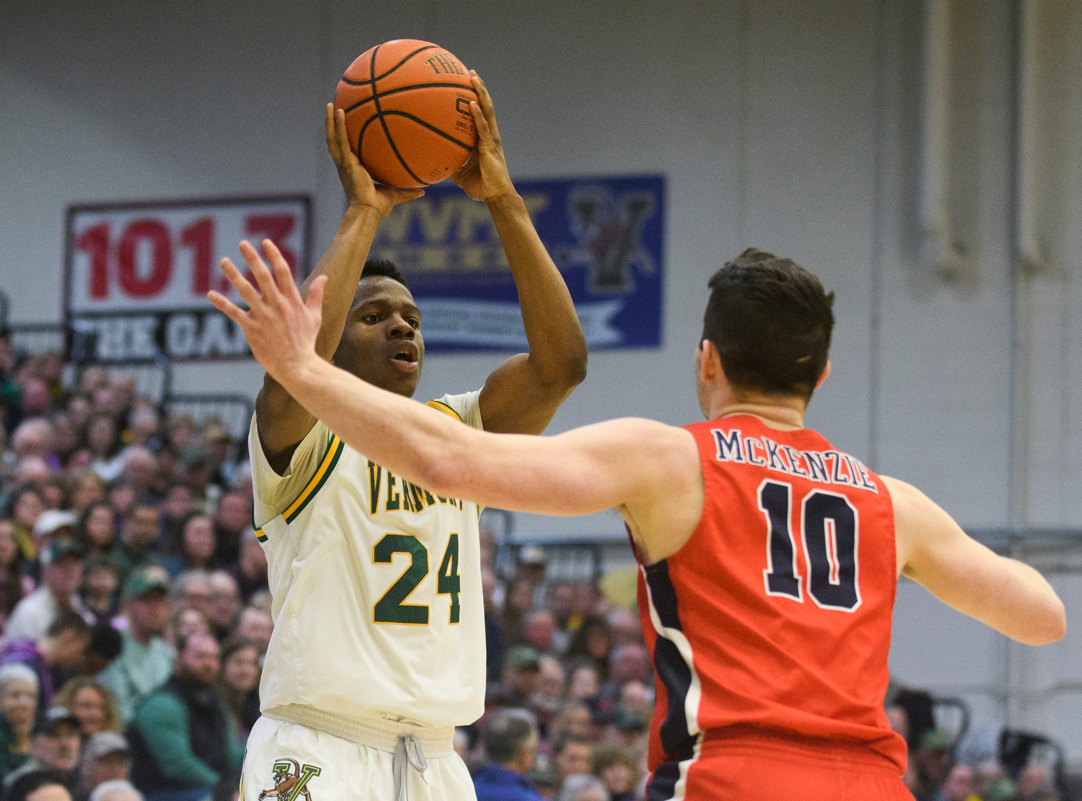 Vermont guard Ben Shungu (24) looks to pass the ball during the men's basketball game between the Stony Brook Seawolves and the Vermont Catamounts at Patrick Gym on Saturday night March 2, 2019 in Burlington, Vermont.