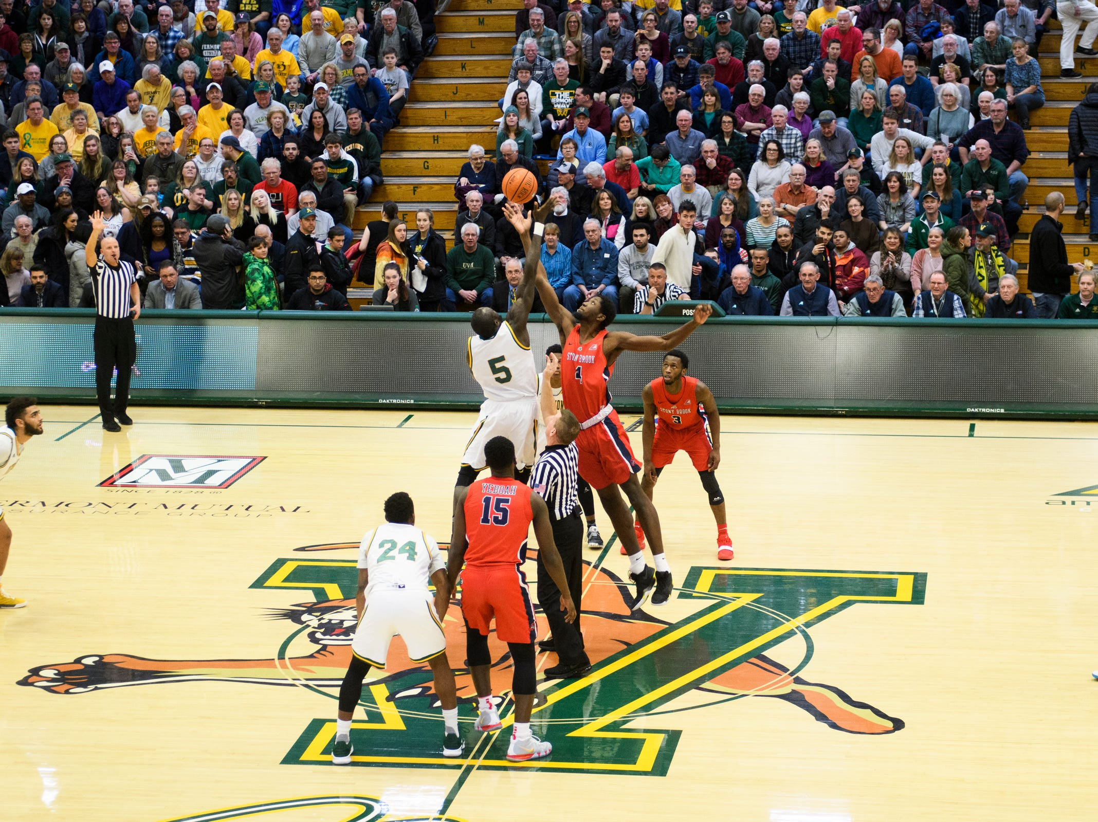 Vermont and Stony Brook battle for the opening tipoff during the men's basketball game between the Stony Brook Seawolves and the Vermont Catamounts at Patrick Gym on Saturday night March 2, 2019 in Burlington, Vermont.