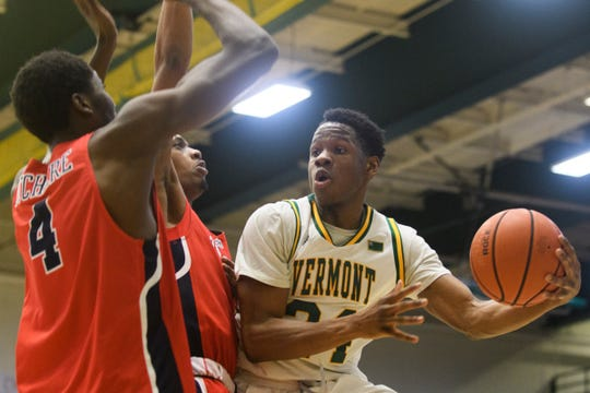 Vermont guard Ben Shungu (24) passes off the ball during the men's basketball game between the Stony Brook Seawolves and the Vermont Catamounts at Patrick Gym on Saturday night March 2, 2019 in Burlington, Vermont.