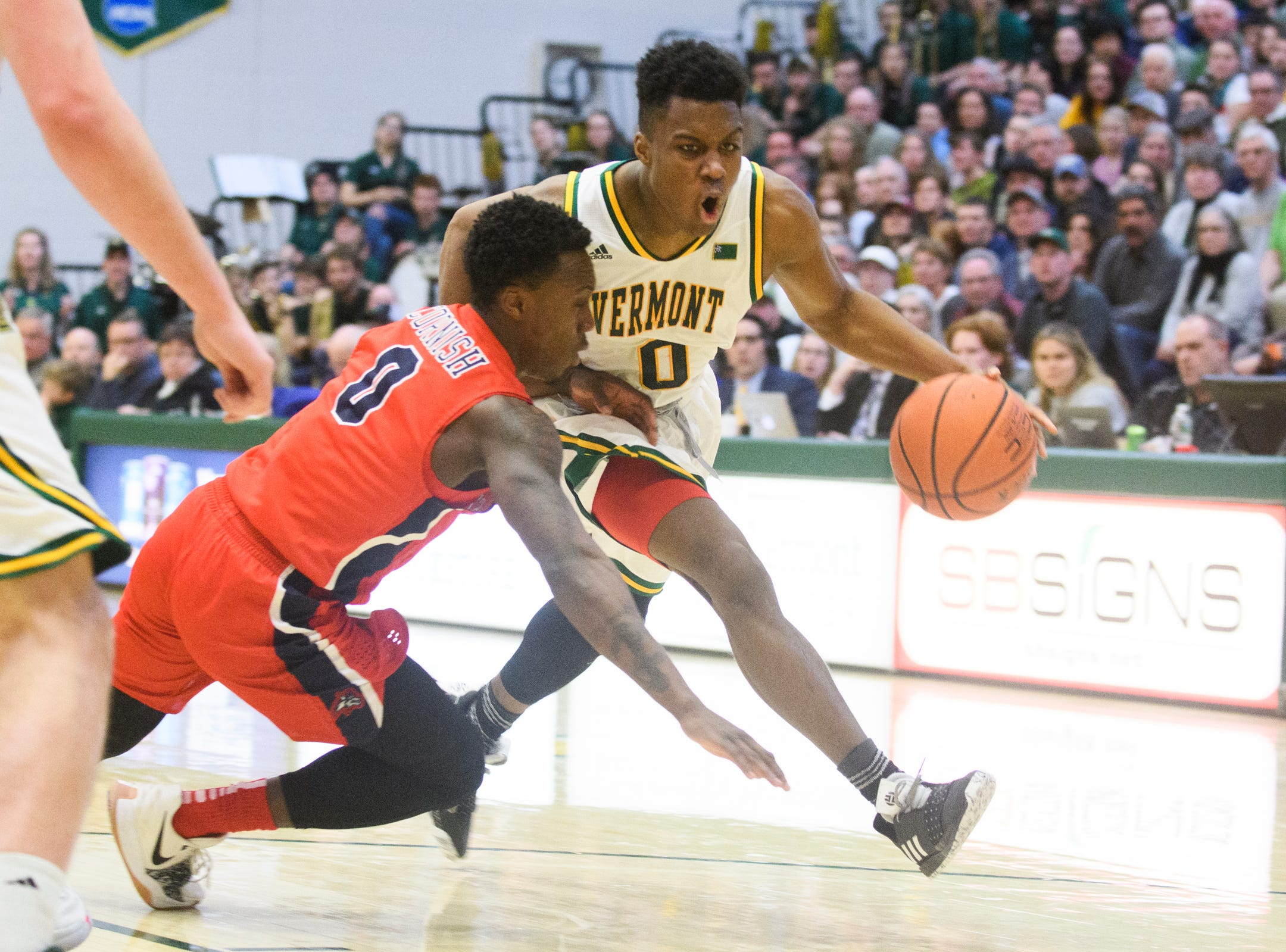Vermont guard Stef Smith (0) drives to the hoop past Stony Brook's Jaron Cornish (0) during the men's basketball game between the Stony Brook Seawolves and the Vermont Catamounts at Patrick Gym on Saturday night March 2, 2019 in Burlington, Vermont.