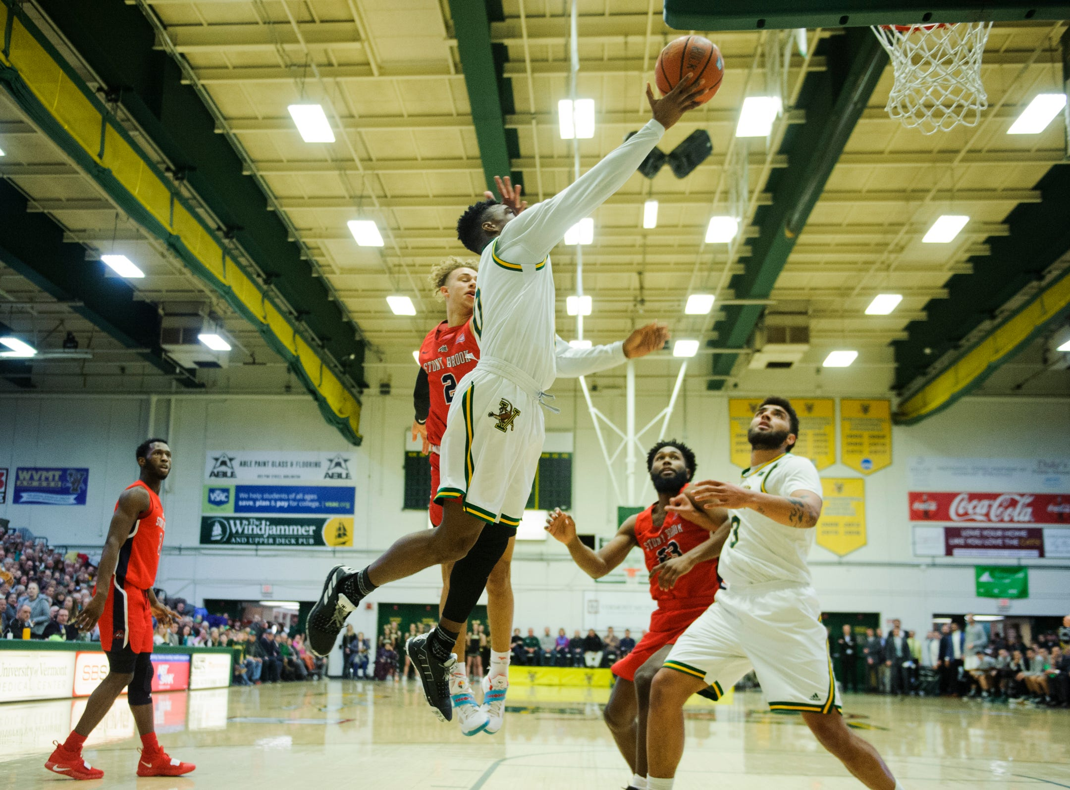 Vermont guard Stef Smith (0) leaps for a lay up during the men's basketball game between the Stony Brook Seawolves and the Vermont Catamounts at Patrick Gym on Saturday night March 2, 2019 in Burlington, Vermont.