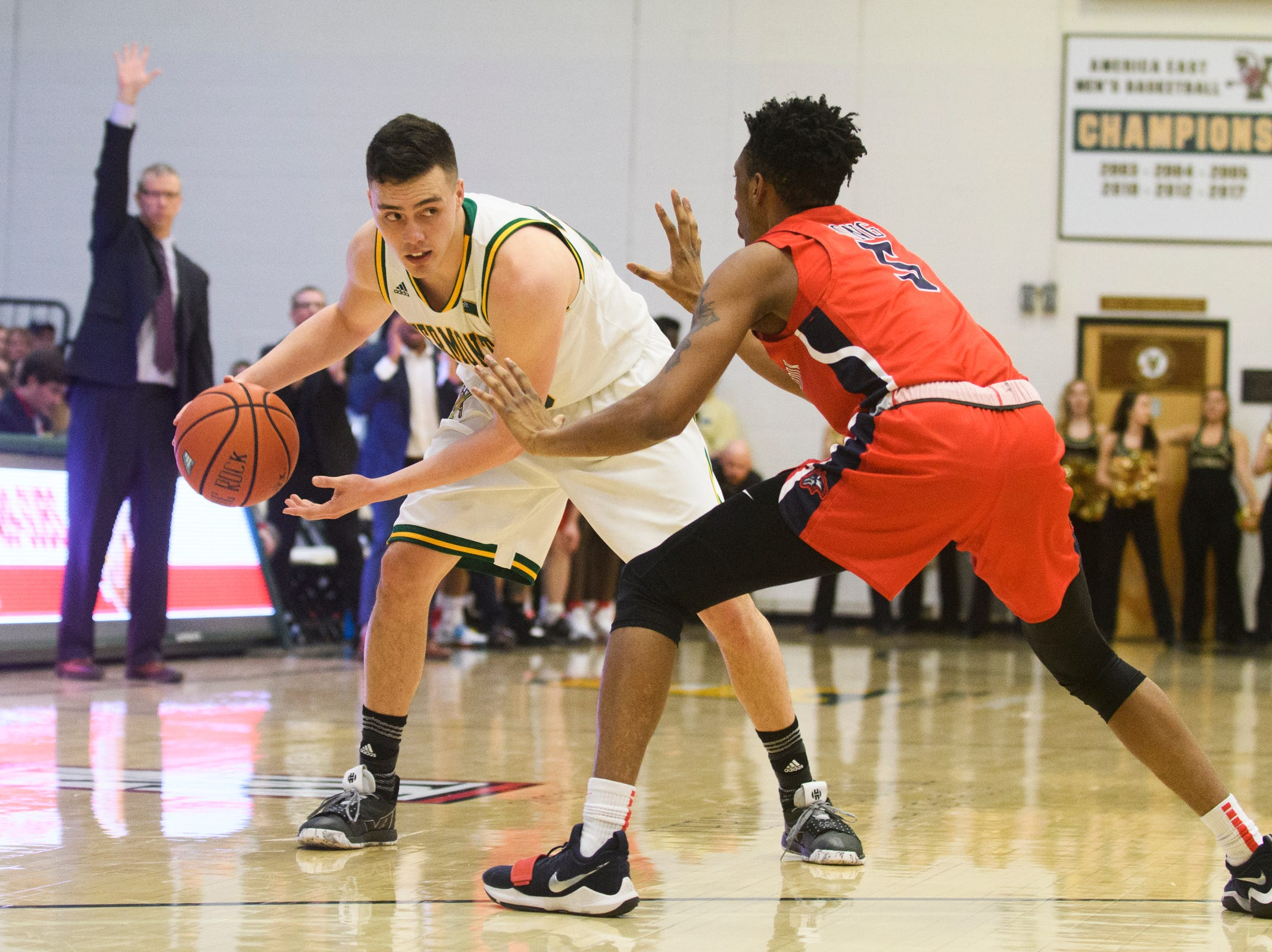 Vermont guard Ernie Duncan (20) is guarded by Stony Brook's Corry Long (5) during the men's basketball game between the Stony Brook Seawolves and the Vermont Catamounts at Patrick Gym on Saturday night March 2, 2019 in Burlington, Vermont.