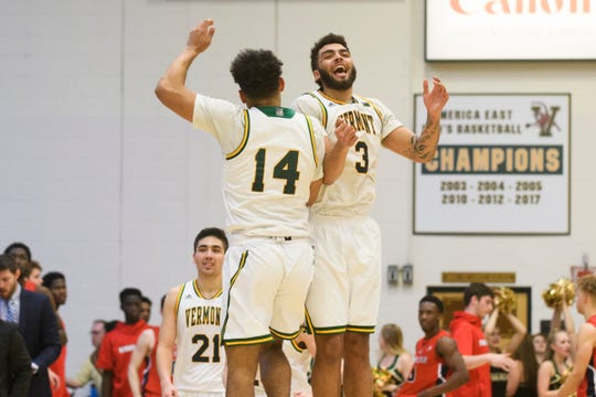 Vermont forward Isaiah Moll (14) and Vermont forward Anthony Lamb (3) celebrate at the conclusion of the men's basketball game between the Stony Brook Seawolves and the Vermont Catamounts at Patrick Gym on Saturday night March 2, 2019 in Burlington, Vermont.