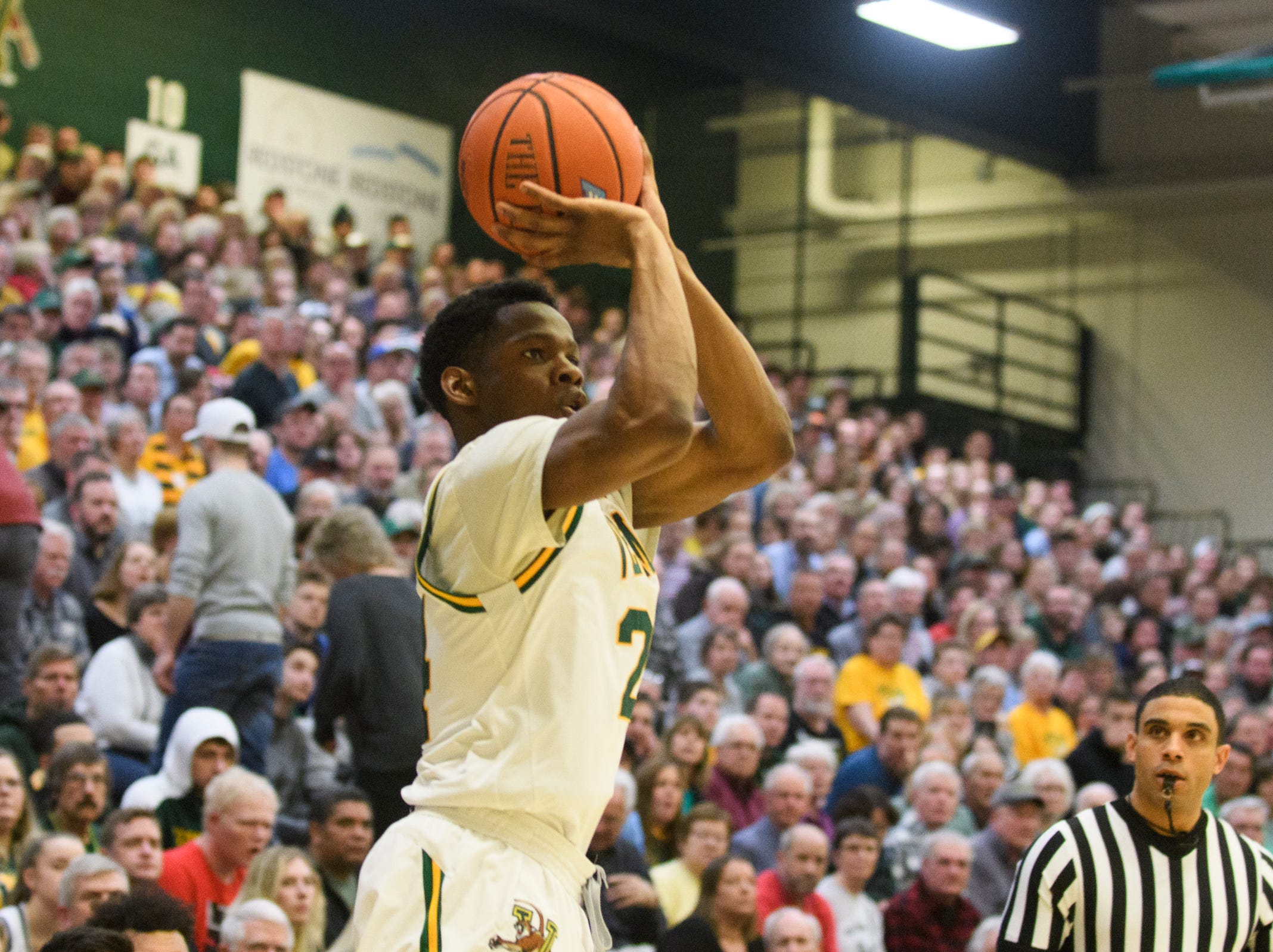 Vermont guard Ben Shungu (24) shoots the ball during the men's basketball game between the Stony Brook Seawolves and the Vermont Catamounts at Patrick Gym on Saturday night March 2, 2019 in Burlington, Vermont.