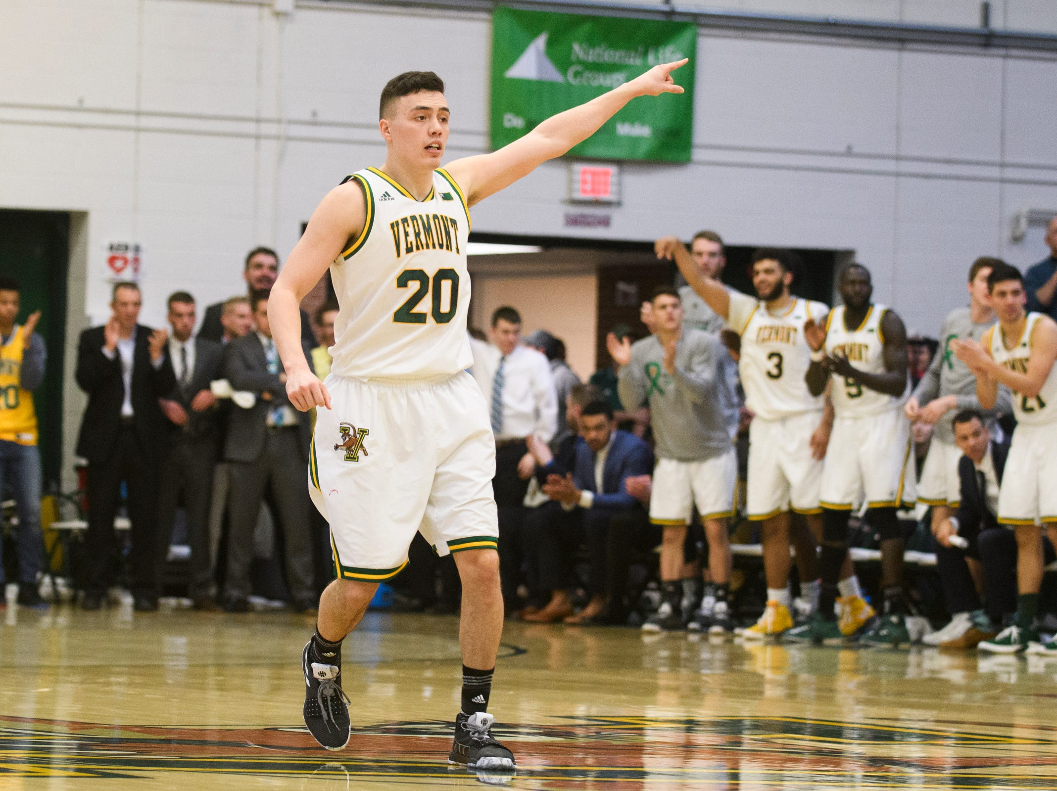 Vermont guard Ernie Duncan (20) points to a player during the men's basketball game between the Stony Brook Seawolves and the Vermont Catamounts at Patrick Gym on Saturday night March 2, 2019 in Burlington, Vermont.