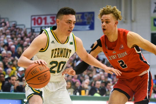 Vermont guard Ernie Duncan (20) drives to the hoop past Stony Brook's Miles Latimer (2) during the men's basketball game between the Stony Brook Seawolves and the Vermont Catamounts at Patrick Gym on Saturday night March 2, 2019 in Burlington, Vermont.
