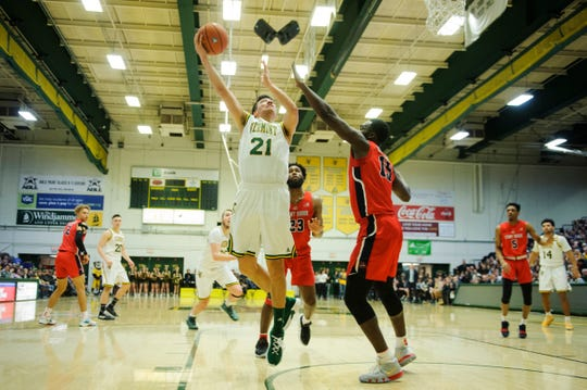 Vermont guard Everett Duncan (21) leaps for a lay up during the men's basketball game between the Stony Brook Seawolves and the Vermont Catamounts at Patrick Gym on Saturday night March 2, 2019 in Burlington, Vermont.