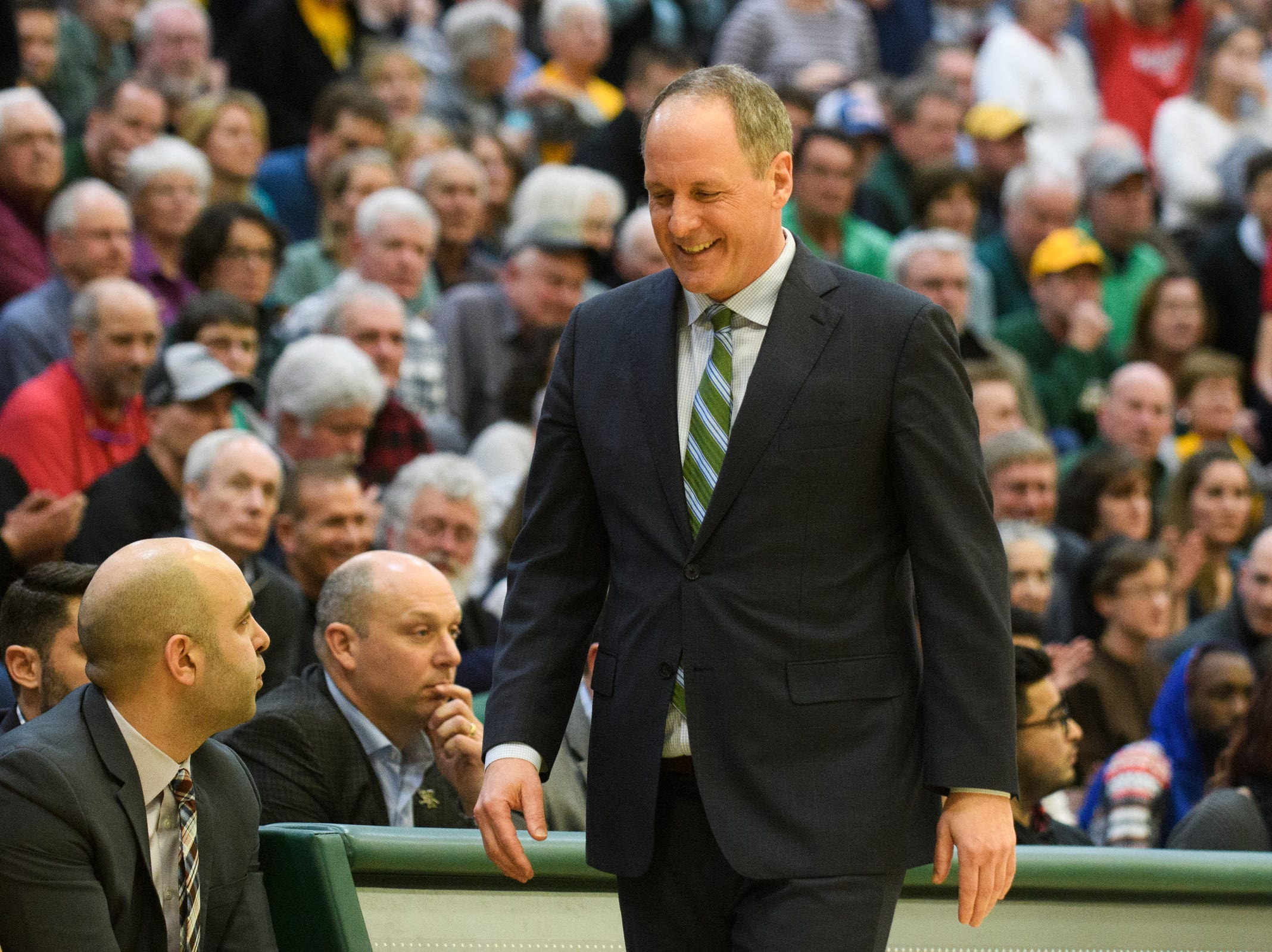Vermont head coach smiles on the sidelines during the men's basketball game between the Stony Brook Seawolves and the Vermont Catamounts at Patrick Gym on Saturday night March 2, 2019 in Burlington, Vermont.