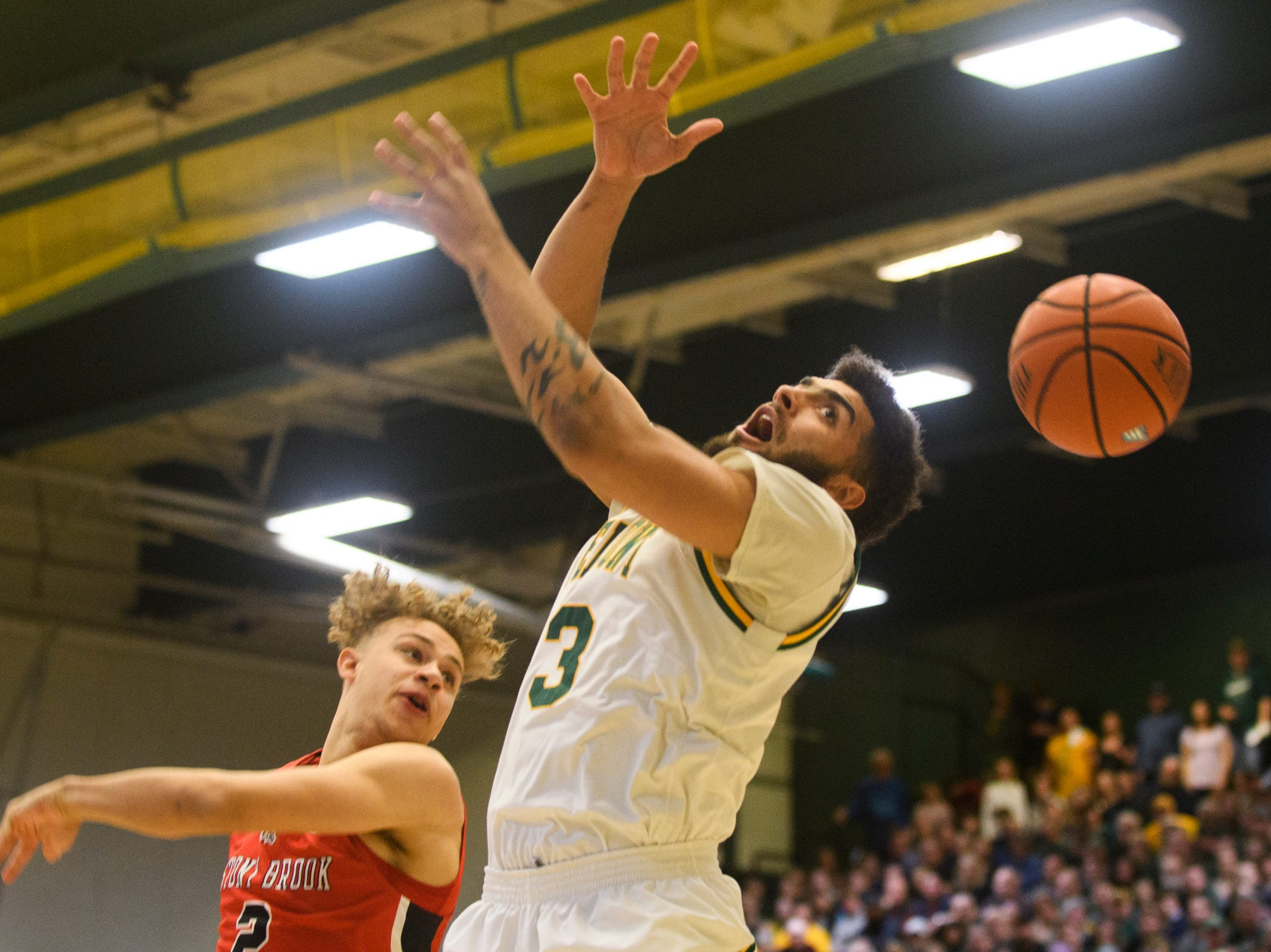 Vermont forward Anthony Lamb (3) loses the ball as he leaps for a lay up during the men's basketball game between the Stony Brook Seawolves and the Vermont Catamounts at Patrick Gym on Saturday night March 2, 2019 in Burlington, Vermont.
