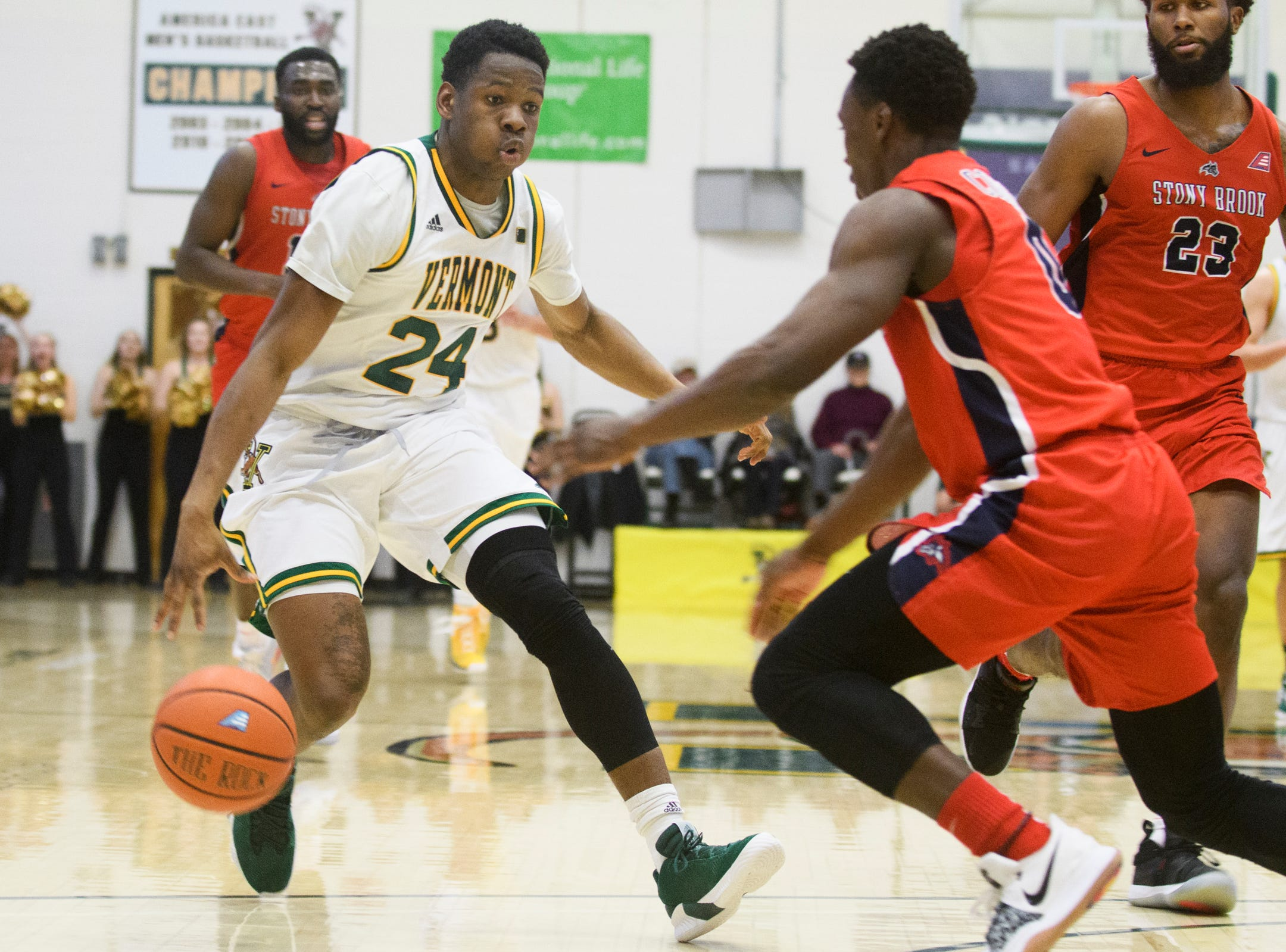 Vermont guard Ben Shungu (24) drives to the hoop during the men's basketball game between the Stony Brook Seawolves and the Vermont Catamounts at Patrick Gym on Saturday night March 2, 2019 in Burlington, Vermont.