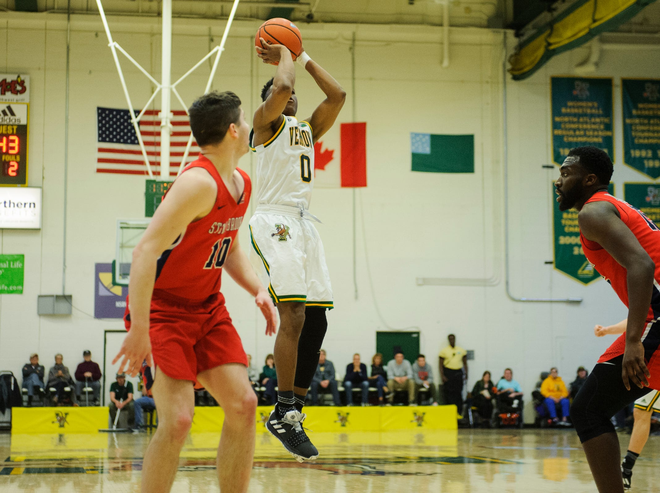 Vermont guard Stef Smith (0) shoots the ball during the men's basketball game between the Stony Brook Seawolves and the Vermont Catamounts at Patrick Gym on Saturday night March 2, 2019 in Burlington, Vermont.