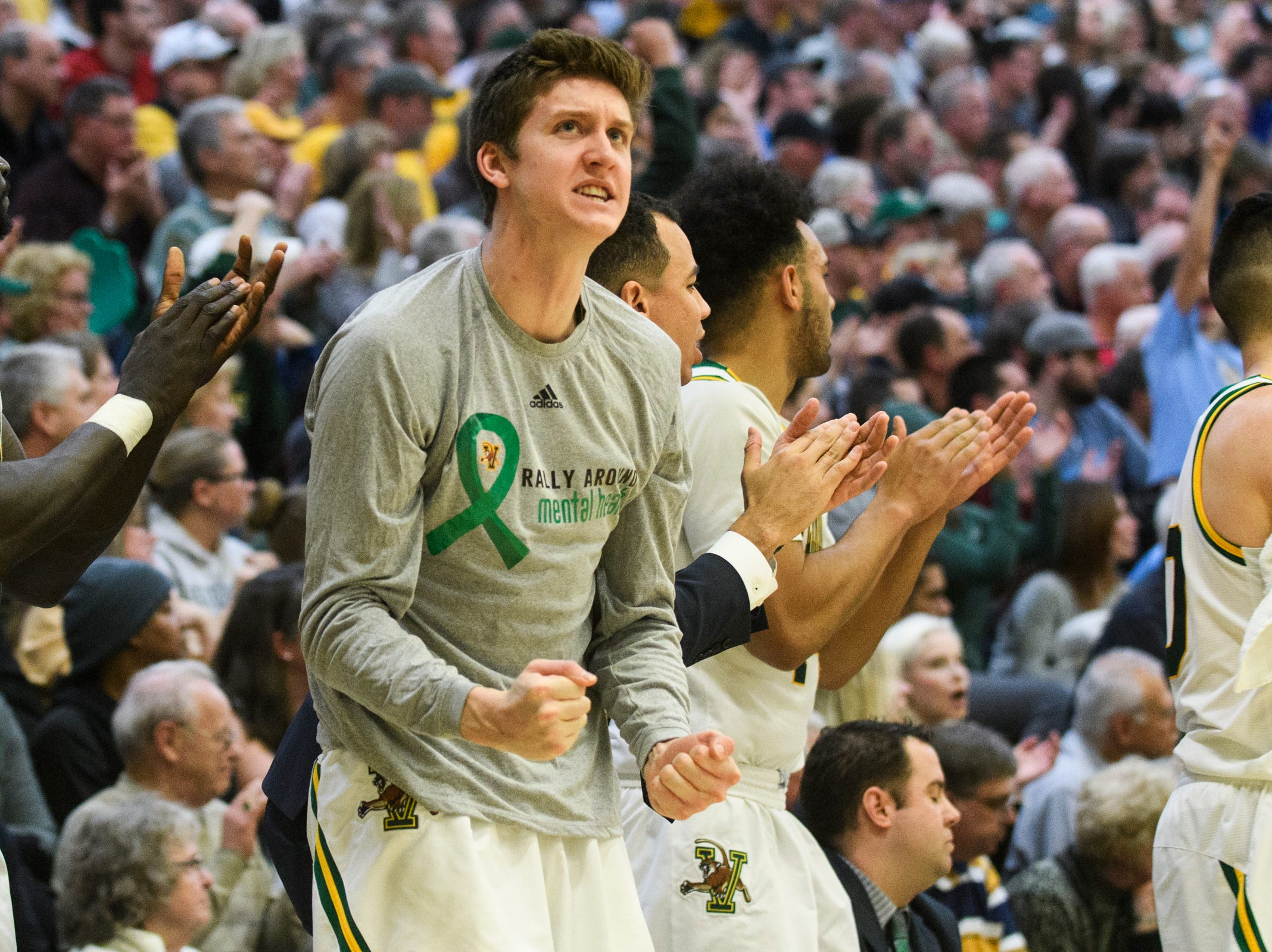 Vermont forward Bailey Patella (12) cheers for the team during the men's basketball game between the Stony Brook Seawolves and the Vermont Catamounts at Patrick Gym on Saturday night March 2, 2019 in Burlington, Vermont.