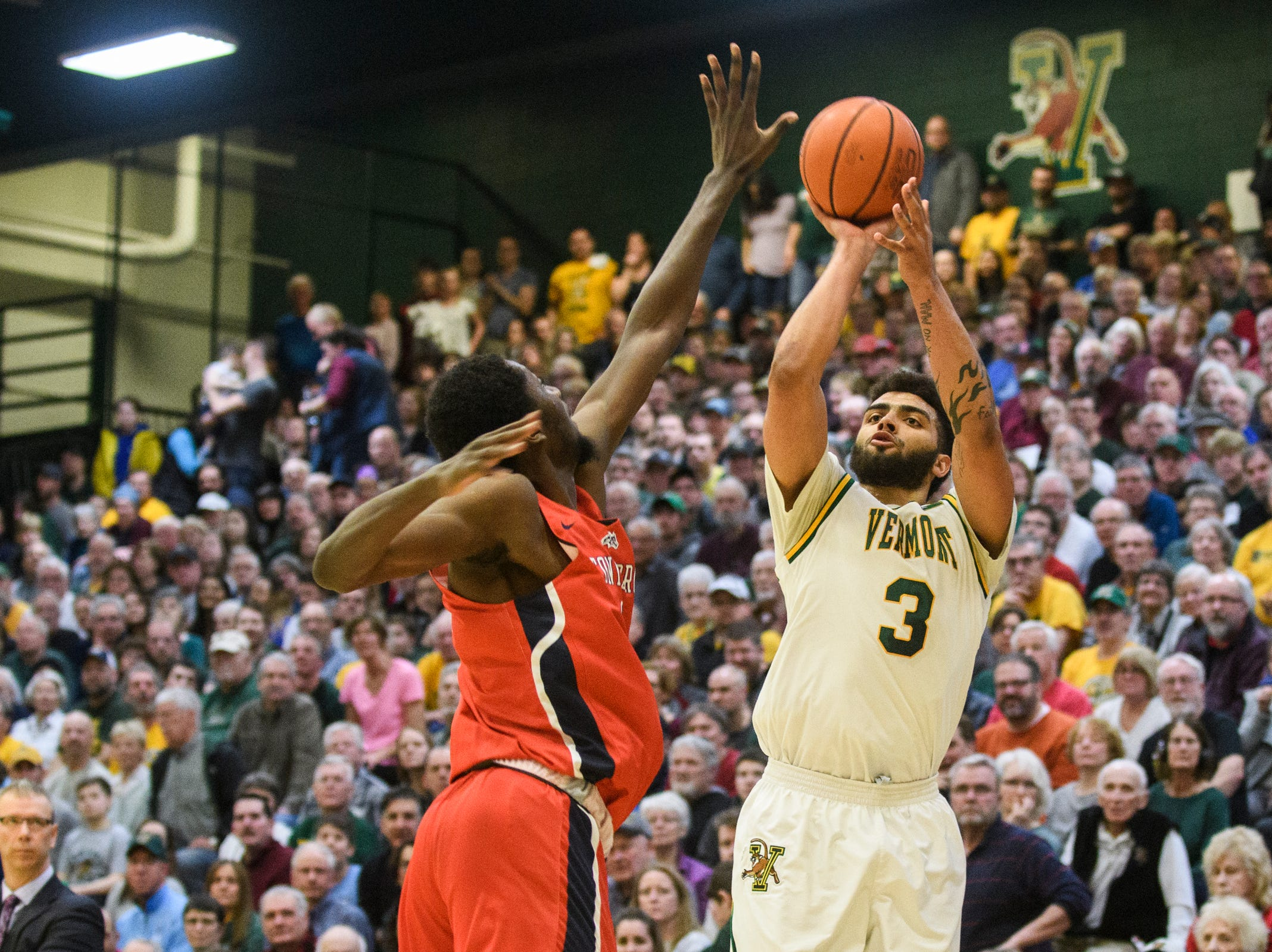 Vermont forward Anthony Lamb (3) shoots a three pointer during the men's basketball game between the Stony Brook Seawolves and the Vermont Catamounts at Patrick Gym on Saturday night March 2, 2019 in Burlington, Vermont.
