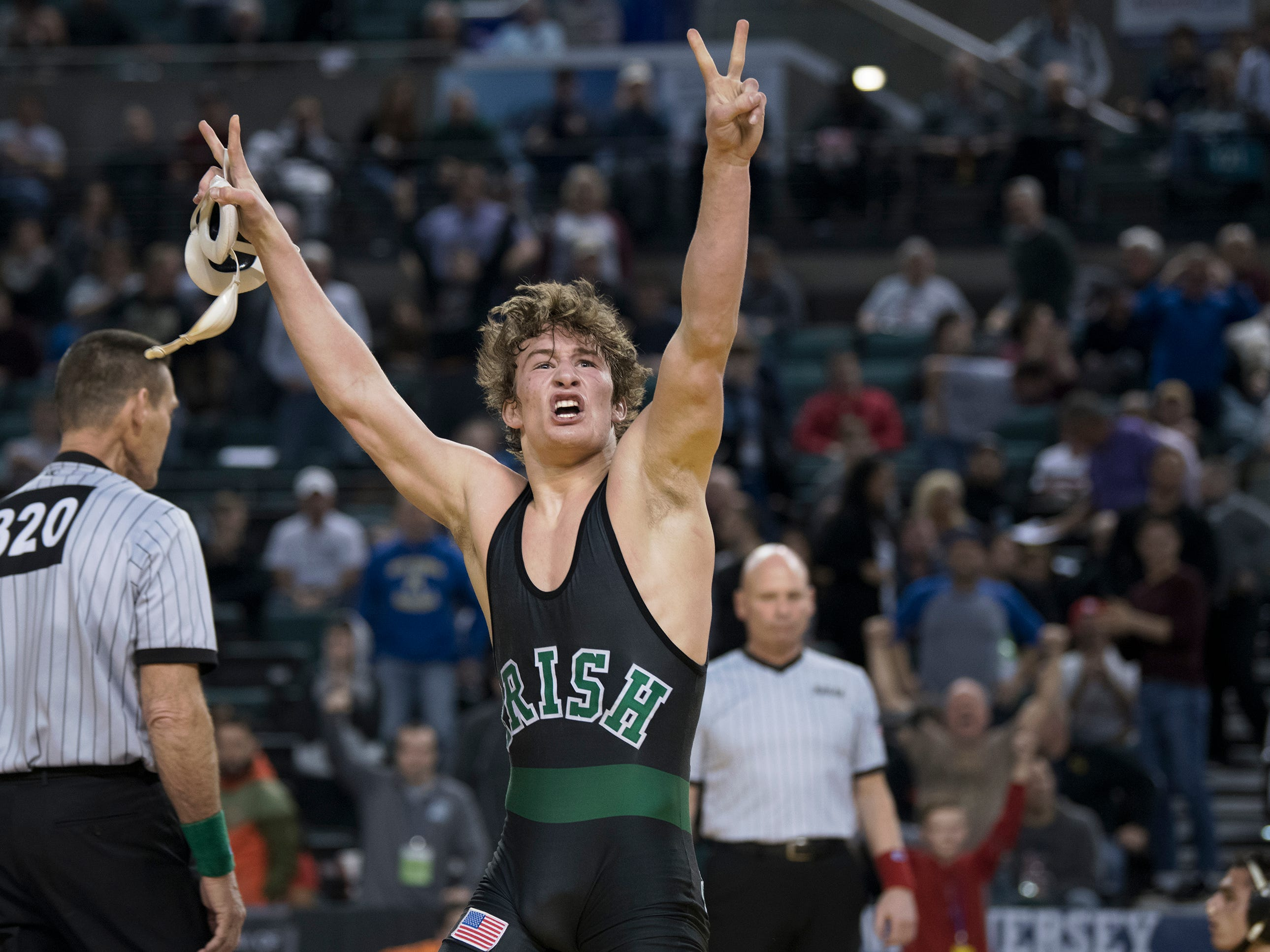 Camden Catholic's Lucas Revano celebrates his second state title after he pinned DePaul's Ricky Cabanillas in overtime of the 145 lb. championship bout of the 2019 NJSIAA State Wrestling Championships tournament held at Boardwalk Hall in Atlantic City on Saturday, March 2, 2019.