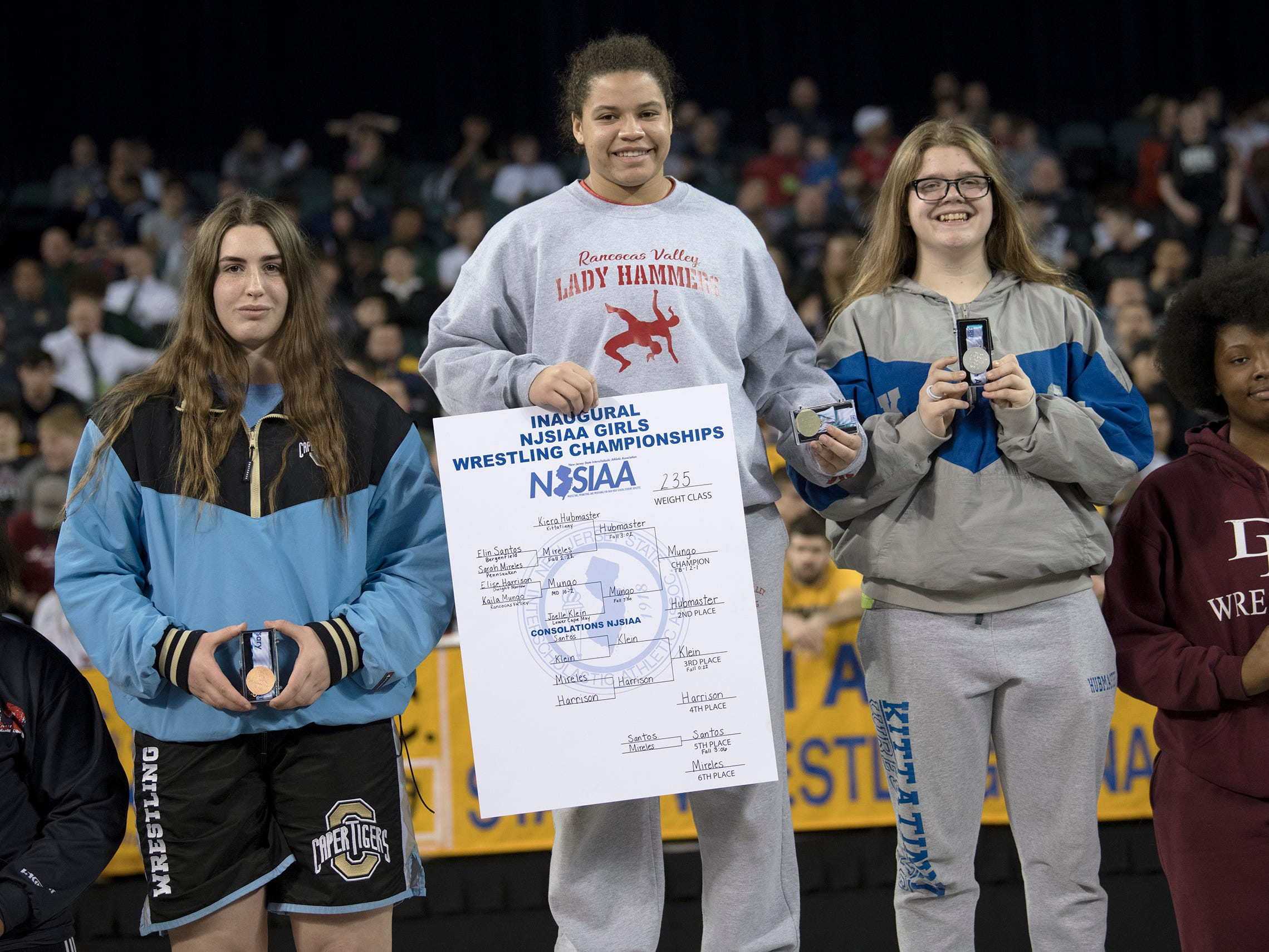Rancocas Valley's Kaila Mungo, center, stands atop the podum after defeating Kittatinny's Kiera Hubmaster, 2-1, in the 235 lb. championship bout of the 2019 NJSIAA Girls State Wrestling Championships tournament held at Boardwalk Hall in Atlantic City on Saturday, March 2, 2019.