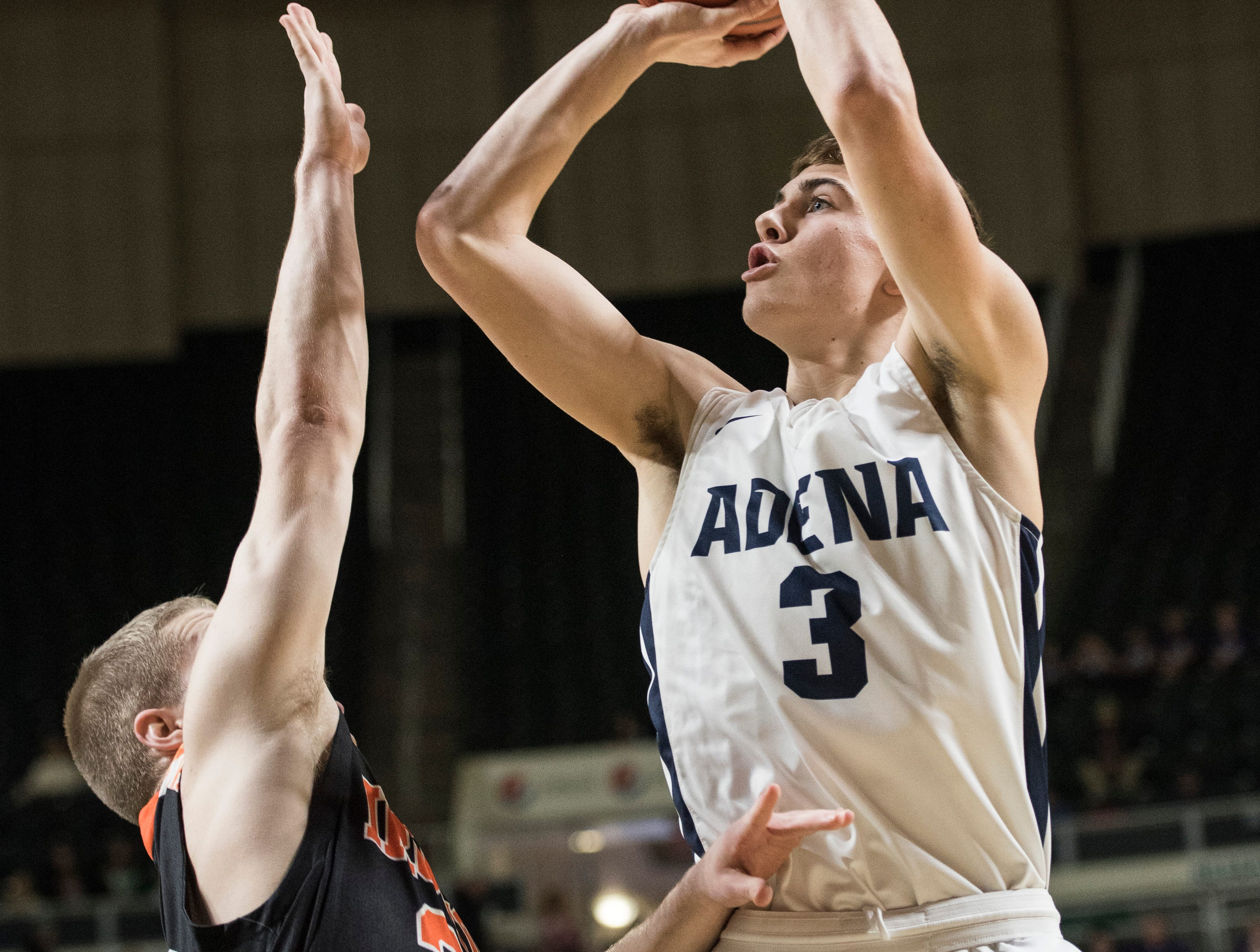 Adena senior Zach Fout scores against Ironton Saturday night in a Division III district semifinal game. Fout's 20-point game helped Adena clench the win over Ironton to send them to the district finals.