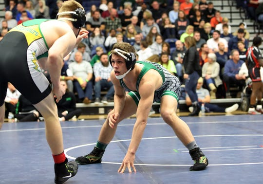 Christopher Donathan from Mason squares off against Andrew Knick from Northmont in the 145 lbs. championship match at the OHSAA Division I Southwest district finals at Fairmont High School Trent Arena.