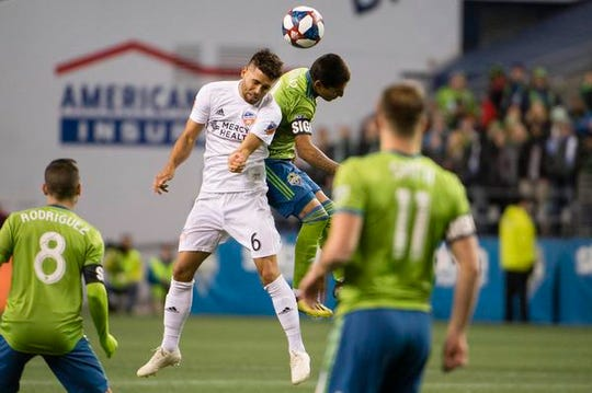 Mar 2, 2019; Seattle, WA, USA; FC Cincinnati midfielder Leonardo Bertone (6) battles for a header against Seattle Sounders forward Raul Ruidiaz (9) during the first half at CenturyLink Field. Mandatory Credit: Troy Wayrynen-USA TODAY Sports