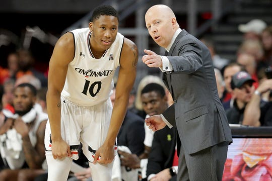 Cincinnati Bearcats head coach Mick Cronin talks with Cincinnati Bearcats guard Rashawn Fredericks (10) in the first half of an NCAA college basketball game against the Memphis Tigers, Saturday, March 2, 2019, at Fifth Third Arena in Cincinnati.