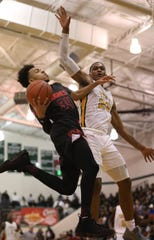 Hughes guard Paul McMillan drives to the basket Taft forward Nekhi Smith during their tournament game, Saturday, March 2, 2019. McMillan has since transferred to Taft.
