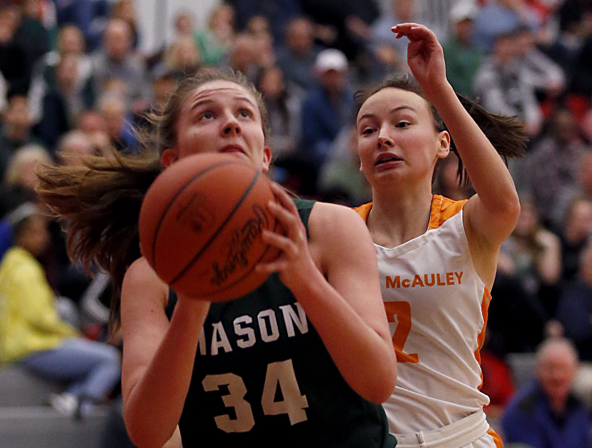 Mason's Marilyn Popplewell goes to the hoop for two against Mercy McAuley during the Southwest District Girls Division I finals at Princeton High School in Cincinnati Saturday, March 2, 2019.