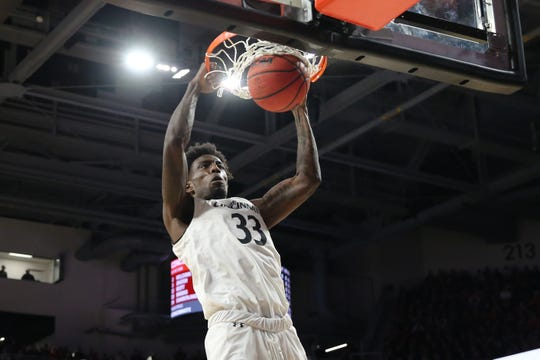 Cincinnati Bearcats center Nysier Brooks (33) dunks in the first half of an NCAA college basketball game against the Memphis Tigers, Saturday, March 2, 2019, at Fifth Third Arena in Cincinnati.