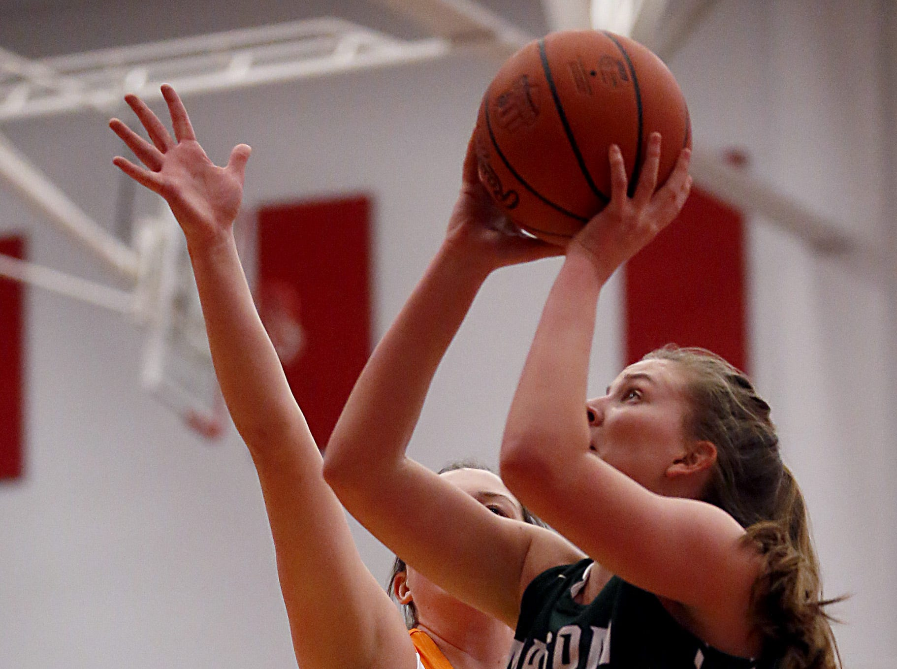 Mason's Marilyn Popplewell scores two against Mercy McAuley during the Southwest District Girls Division I finals at Princeton High School in Cincinnati Saturday, March 2, 2019.