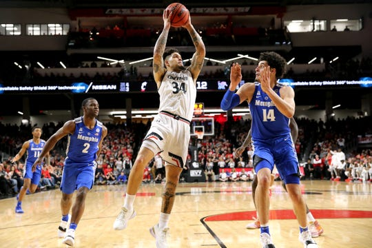 Cincinnati Bearcats guard Jarron Cumberland (34) rises for a shot over Memphis Tigers forward Isaiah Maurice (14) in the first half of an NCAA college basketball game, Saturday, March 2, 2019, at Fifth Third Arena in Cincinnati.