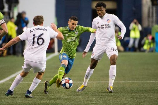 Mar 2, 2019; Seattle, WA, USA; Seattle Sounders midfielder Victor Rodriguez (8) controls a pass against FC Cincinnati midfielder Eric Alexander (16) during the first half at CenturyLink Field. Mandatory Credit: Troy Wayrynen-USA TODAY Sports