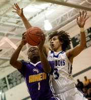 Aiken guard  D'Arris Dean (1) drives to the basket against Wyoming forward Evan Prater during their tournament game Saturday, March 2, 2019.