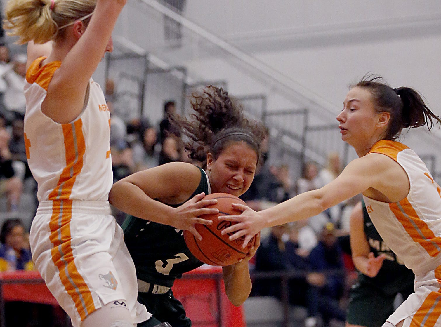 Mason's Sade Tucker is double teamed by Mercy McAuley's Jenna Schoster and Kieran Casey during the Southwest District Girls Division I finals at Princeton High School in Cincinnati Saturday, March 2, 2019.