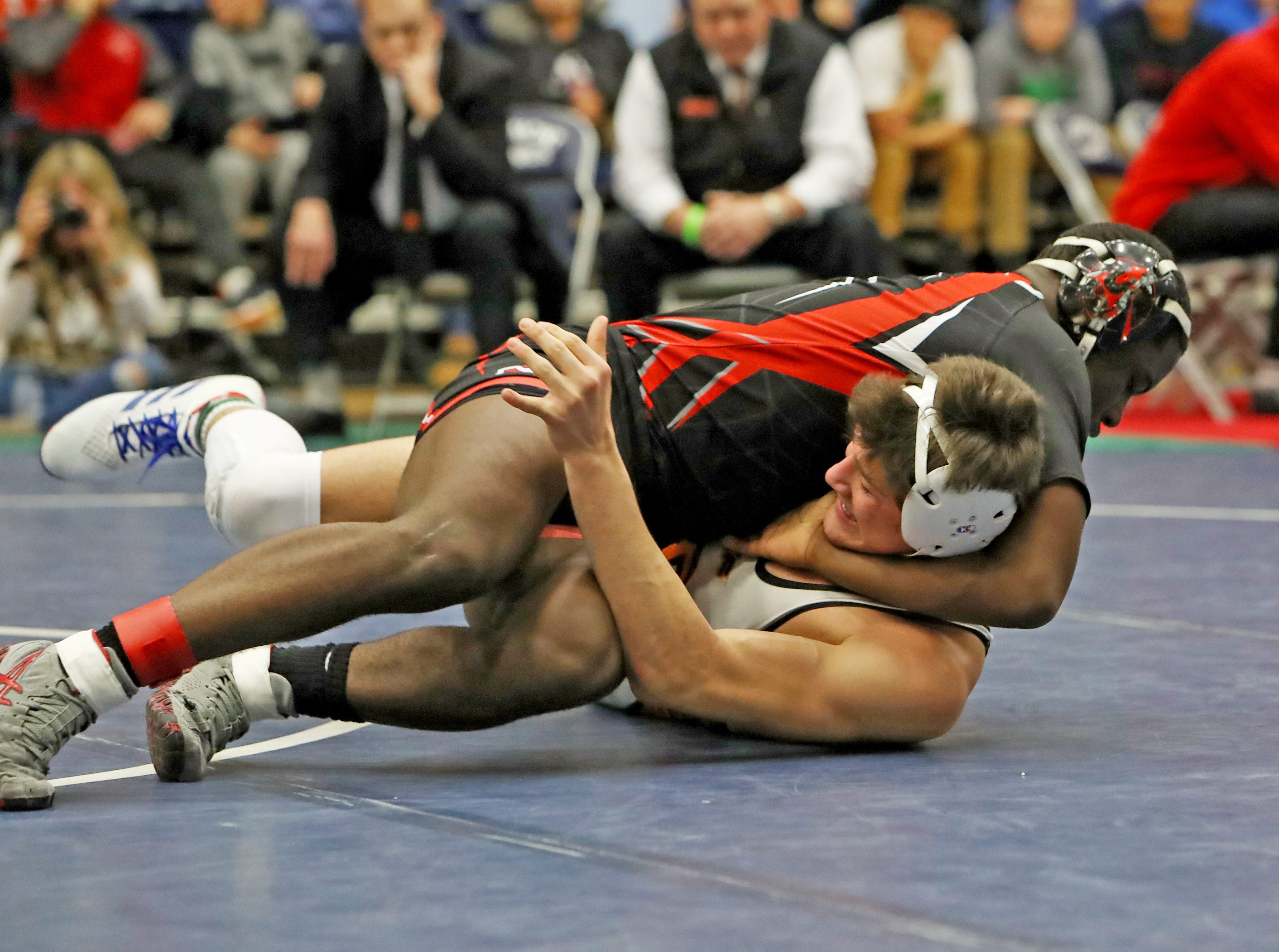 E'Lan Heard from La Salle pins Gavin Bell from Beavercreek to win the 152 lbs. championship at the OHSAA Division I Southwest District finals at Fairmont High School Trent Arena.