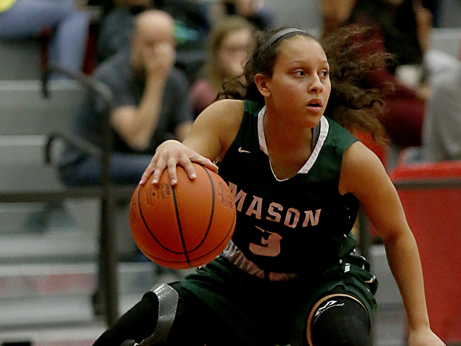 Mason's Sade Tucker moves the ball against Mercy McAuley during the Southwest District Girls Division I finals at Princeton High School in Cincinnati Saturday, March 2, 2019.