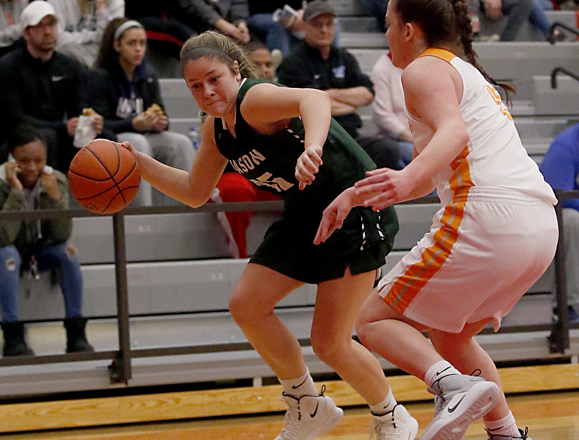 Mason's Beth Moser is covered by Mercy McAuley's Alexandria Smith during the Southwest District Girls Division I finals at Princeton High School in Cincinnati Saturday, March 2, 2019.