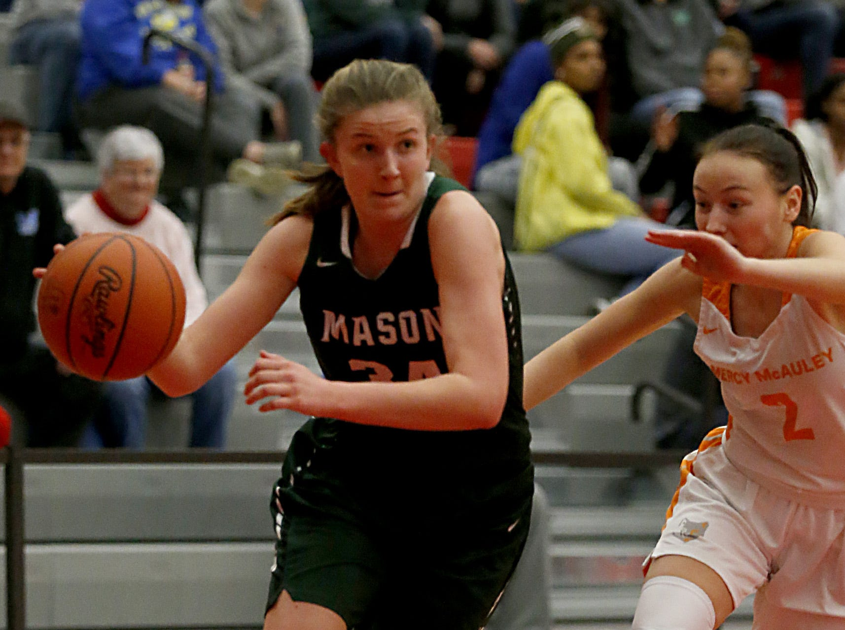 Mason's Marilyn Popplewell is covered by Mercy McAuley's Kieran Casey during the Southwest District Girls Division I finals at Princeton High School in Cincinnati Saturday, March 2, 2019.