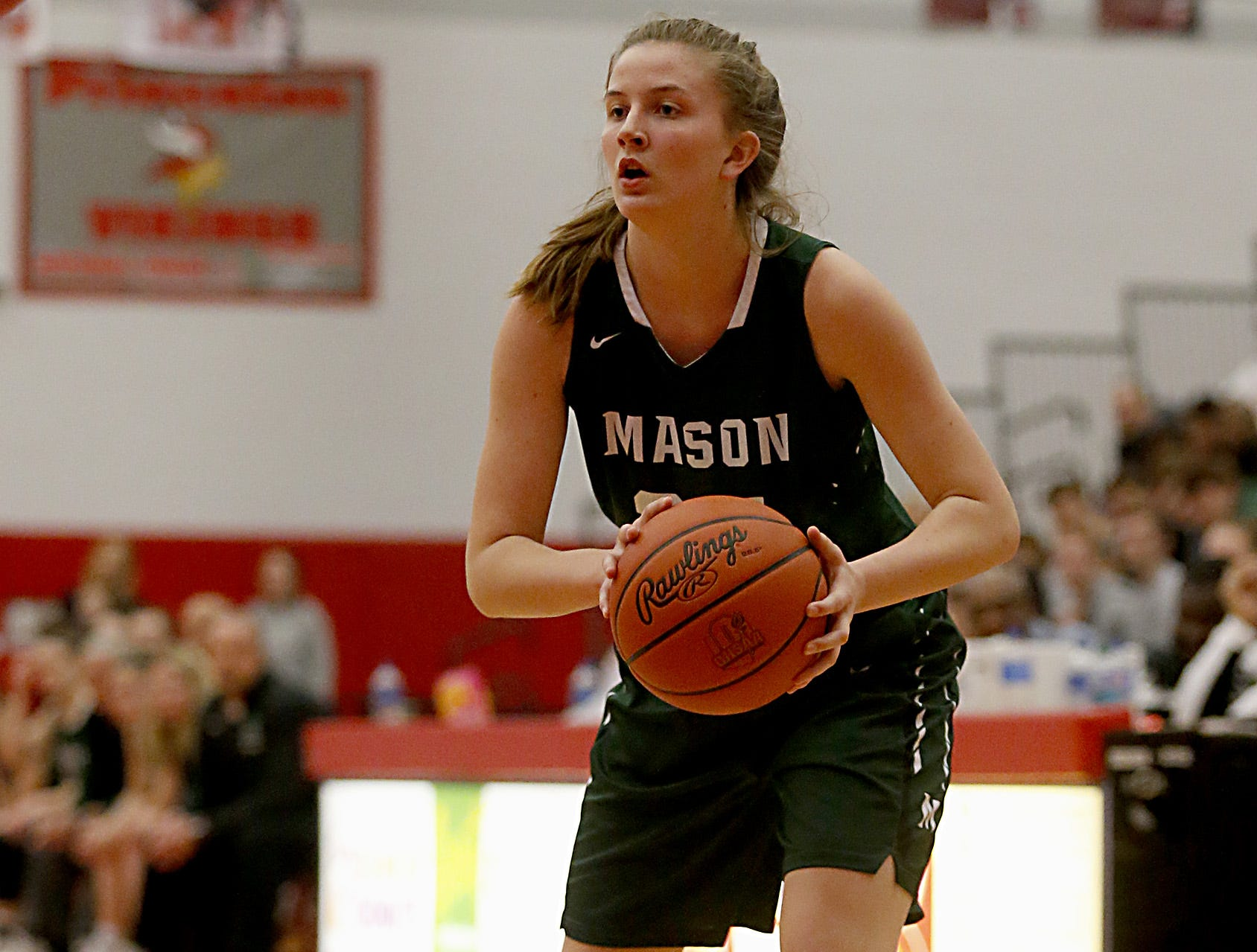 Mason's Marilyn Popplewell looks for a teammate while playing Mercy McAuley during the Southwest District Girls Division I finals at Princeton High School in Cincinnati Saturday, March 2, 2019.
