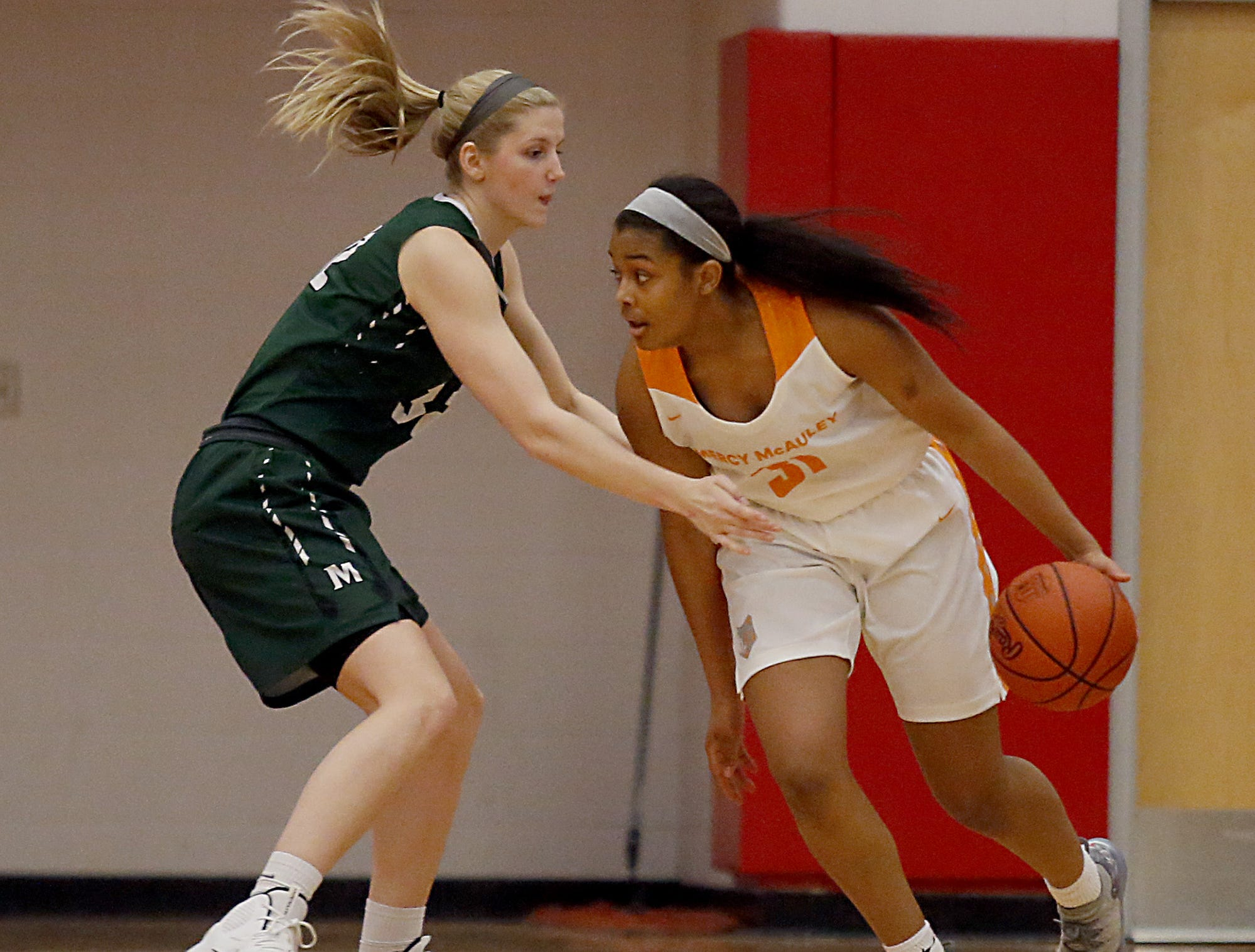 Mercy McAuley's Ashley Tudor is covered by Mason's Sammie Puisis during the Southwest District Girls Division I finals at Princeton High School in Cincinnati Saturday, March 2, 2019.