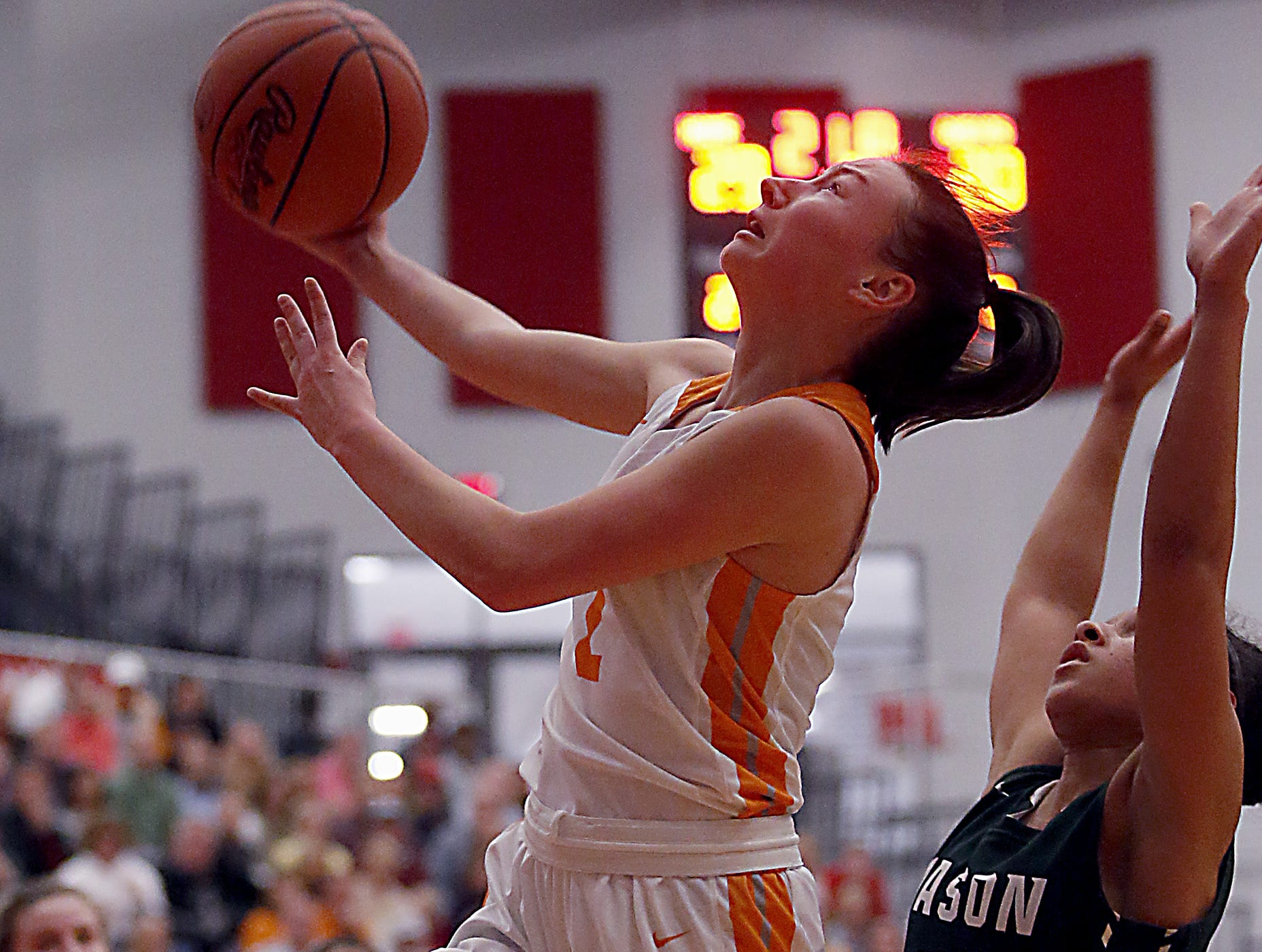 Mercy McAuley's Kieran Casey shoots against Mason during the Southwest District Girls Division I finals at Princeton High School in Cincinnati Saturday, March 2, 2019.