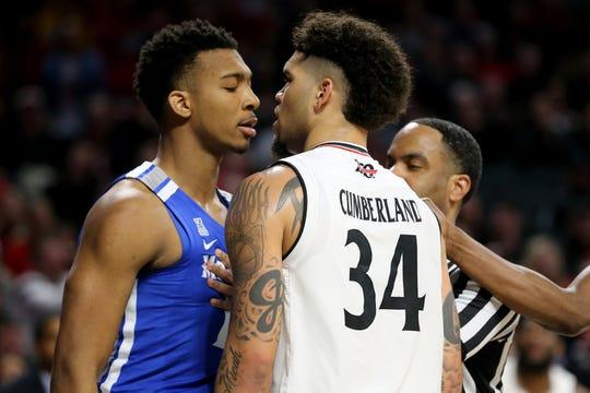 Memphis Tigers guard Antwann Jones (11) and Cincinnati Bearcats guard Jarron Cumberland (34) exchange words in the second half of an NCAA college basketball game, Saturday, March 2, 2019, at Fifth Third Arena in Cincinnati. Cincinnati won 71-69.