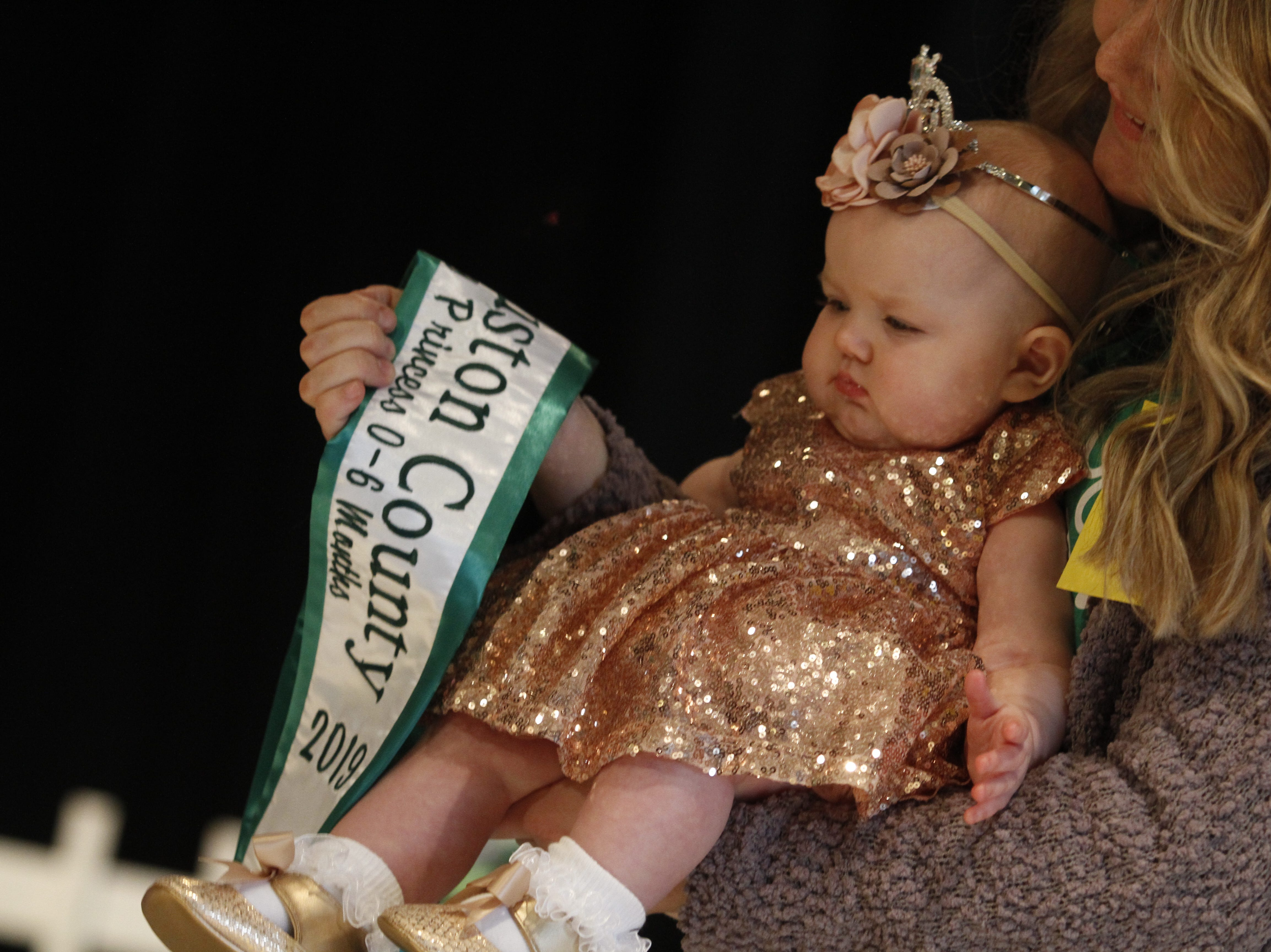 Jade Angelilli is awarded the Houston County Tiny Princess 0-6 Months sash during the 2019 Houston County Tiny Prince, Tiny Princess Pageant at Houston County High School, on Saturday, March 2, 2019 in Erin, Tenn.