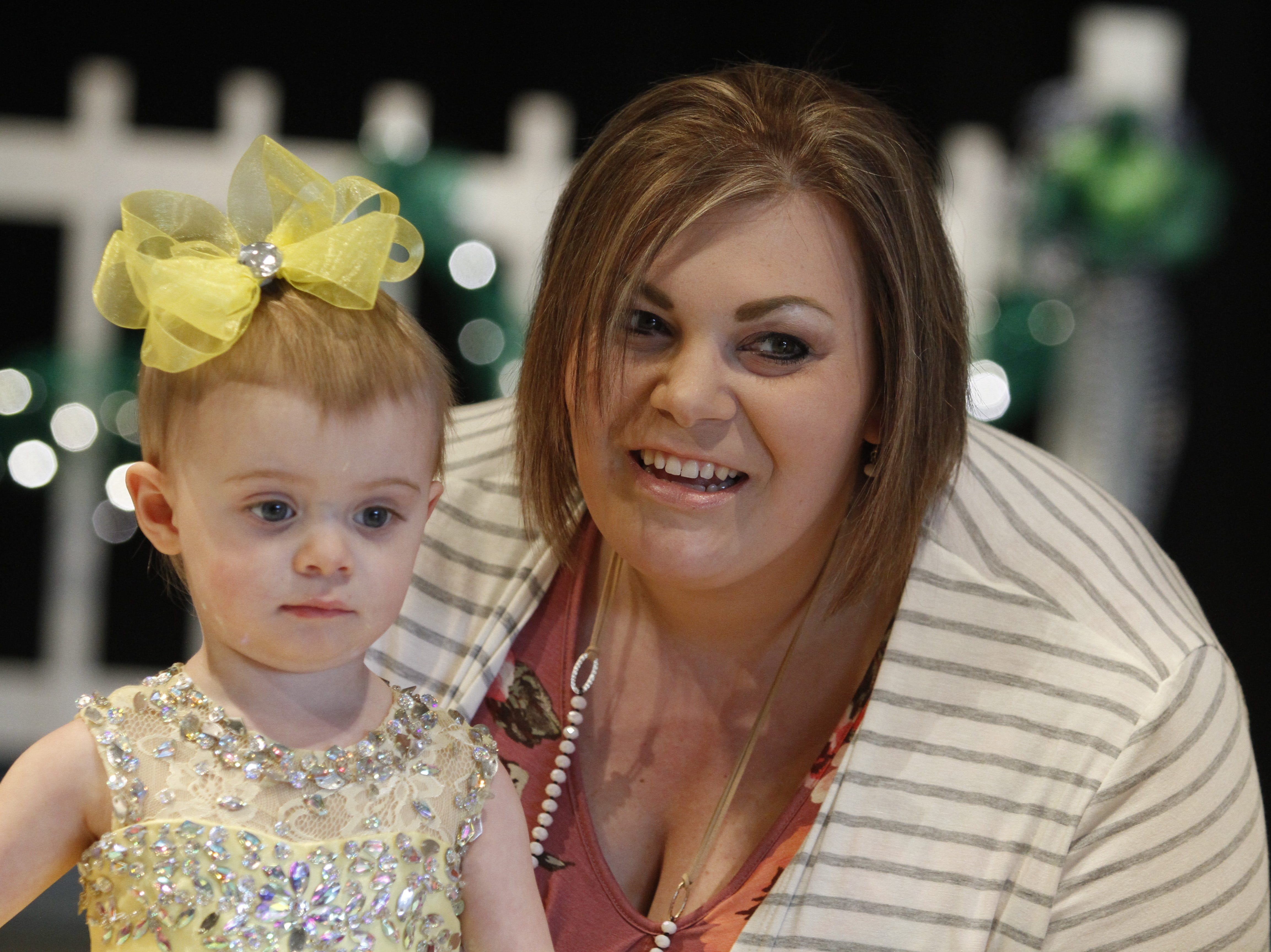 Kami Beard escorts her daughter Gracie Beard as she competes in the Houston County Tiny Princess 1-year-old group during the 2019 Houston County Tiny Prince, Tiny Princess Pageant at Houston County High School, on Saturday, March 2, 2019 in Erin, Tenn.