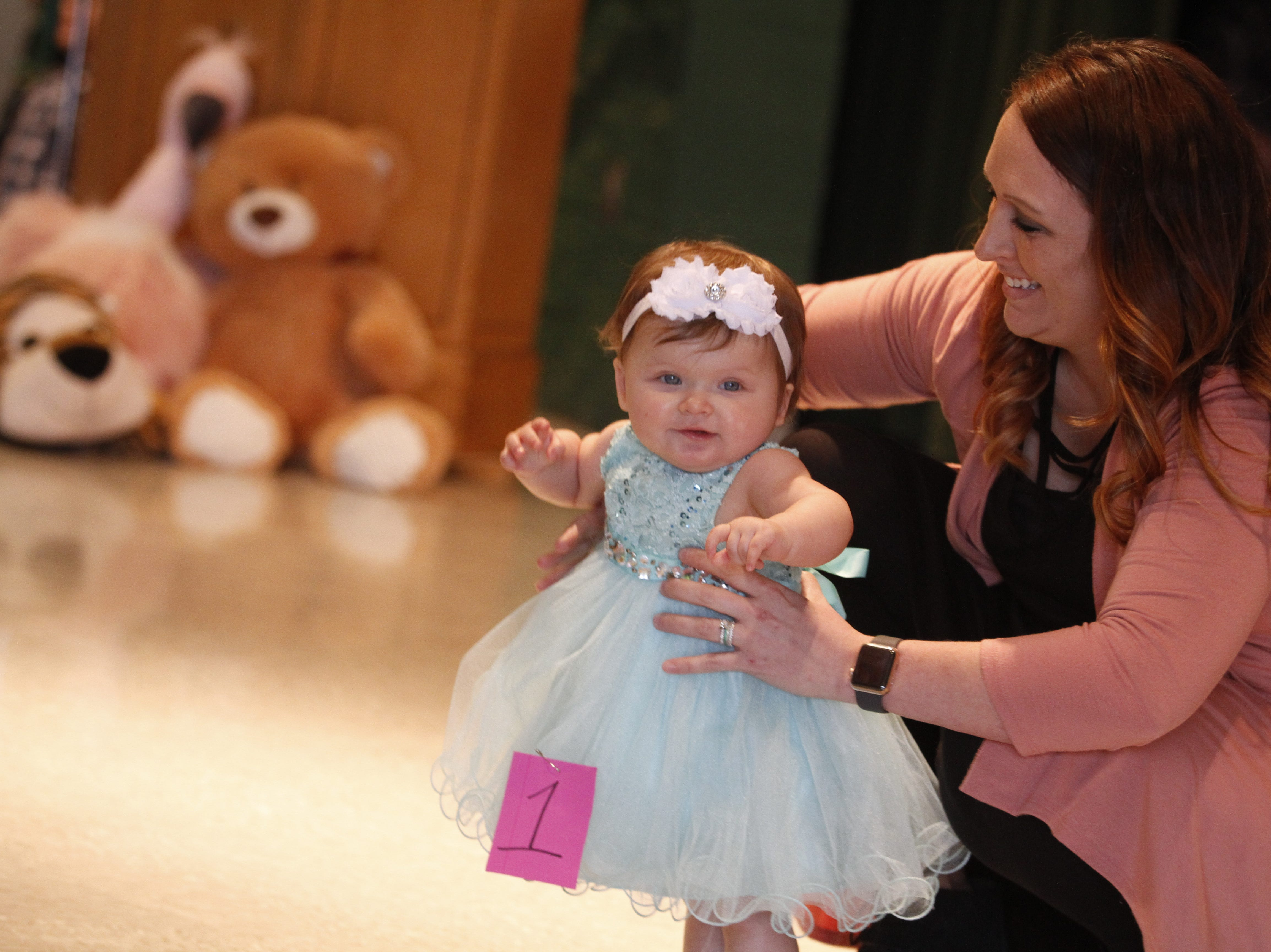 Heather Lewis assists her daughter Blakely as she competes in the Houston County Tiny Princess 7-12 months group during the 2019 Houston County Tiny Prince, Tiny Princess Pageant at Houston County High School, on Saturday, March 2, 2019 in Erin, Tenn.